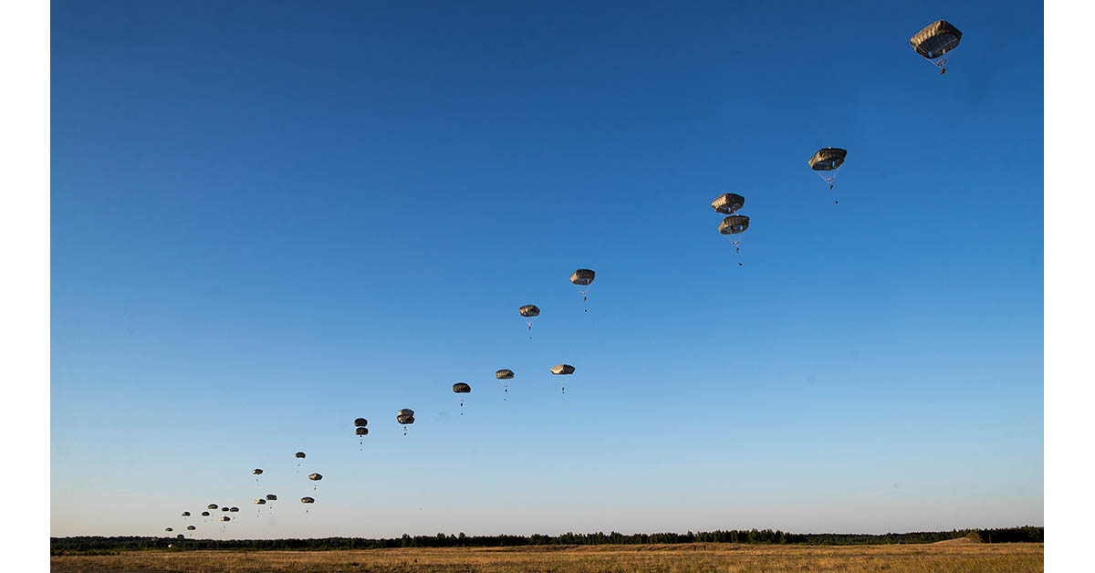 Paratroopers from the 82nd Airborne Division from Fort Bragg, North Carolina, reach the ground after jumping from an Air Force C-17 during a Saber Strike 2018 exercises at the Gaiziunai Training Area in Lithuania. (Mindaugas Kulbis/AP)