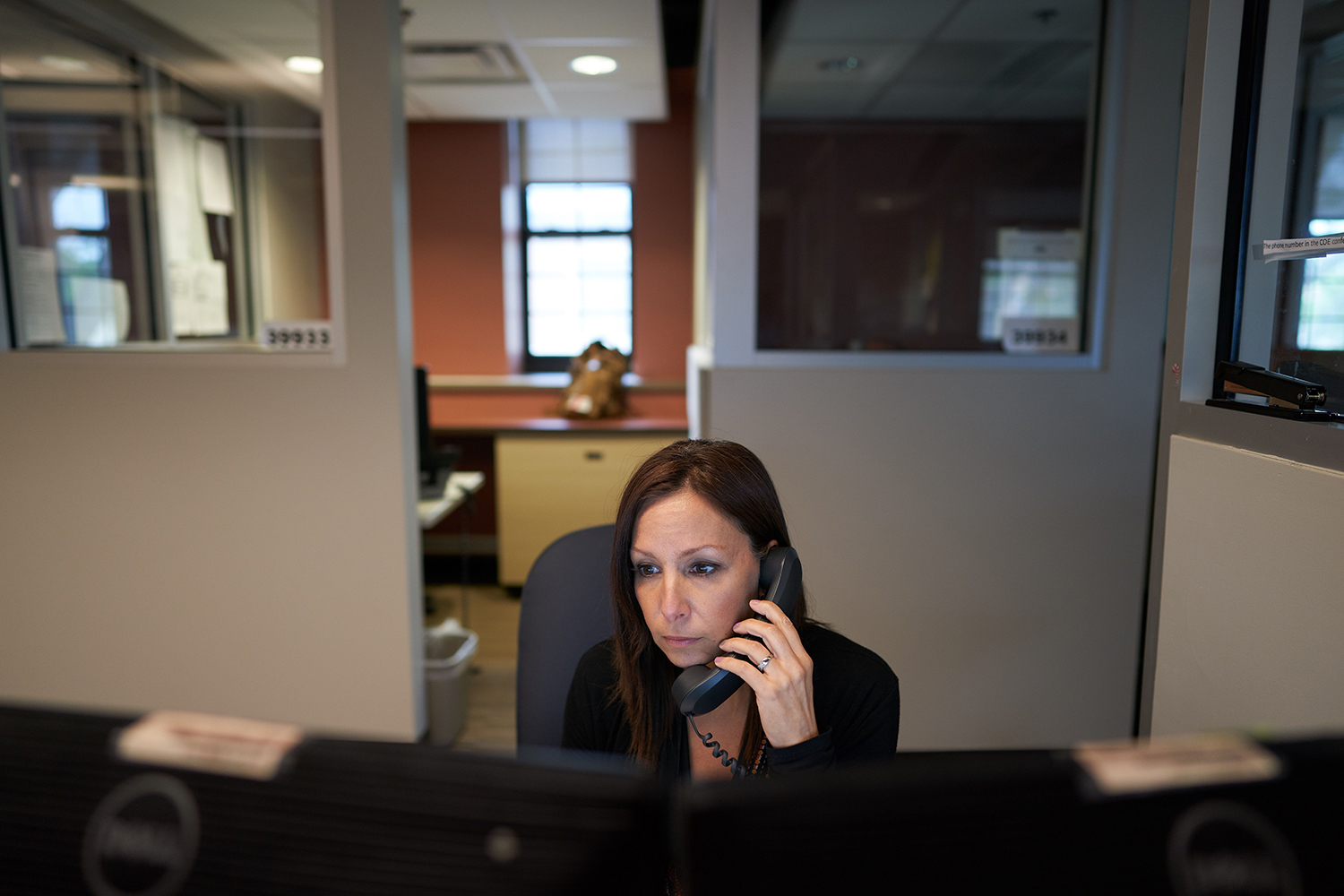 A worker at the Veterans Crisis Line call centre in Canandaigua, N.Y., listens to a call from a veteran on June 4, 2019. (Geoff Robins/AFP via Getty Images)