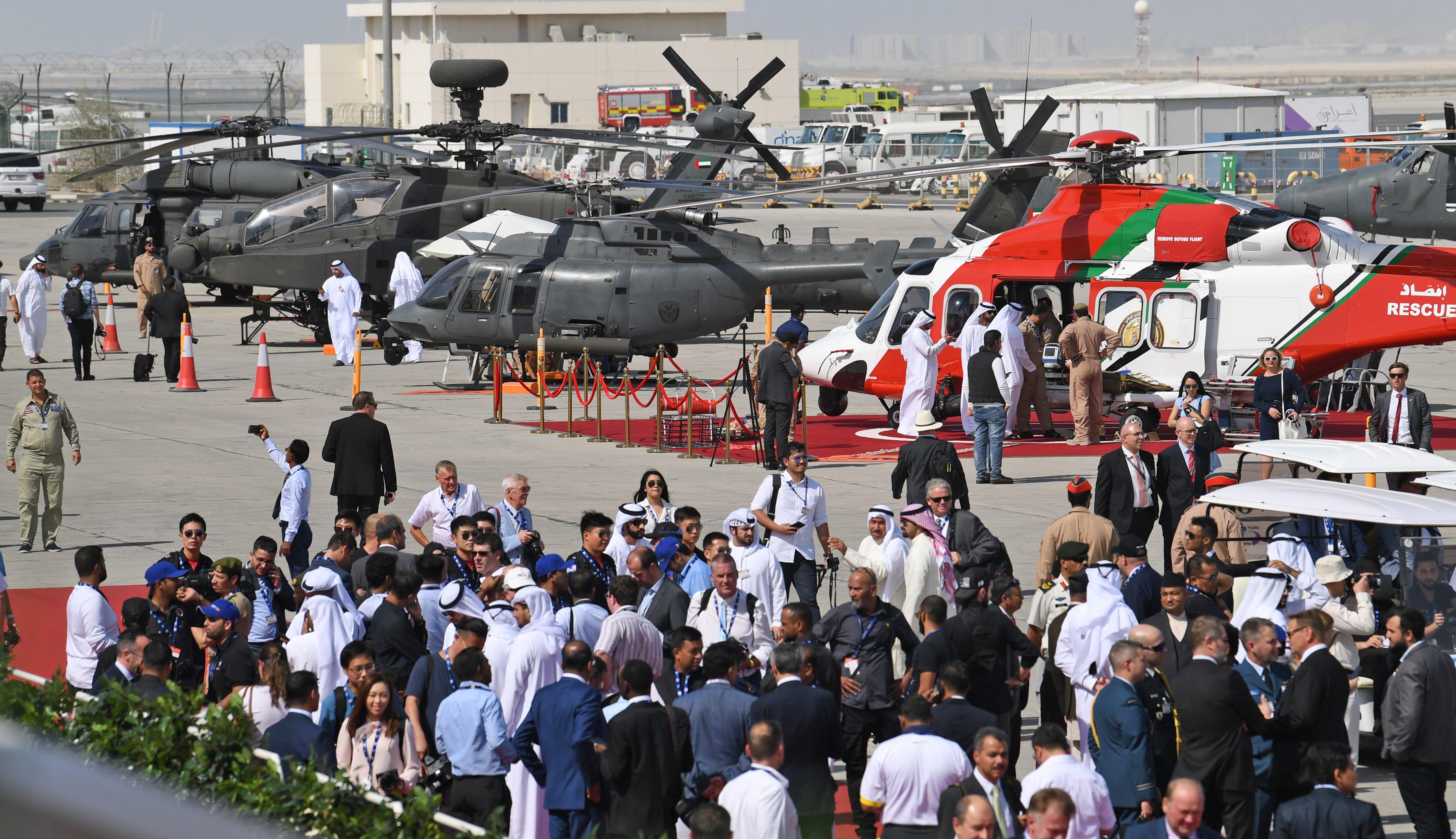 People attend the Dubai Airshow on November 18, 2019. (KARIM SAHIB / AFP)