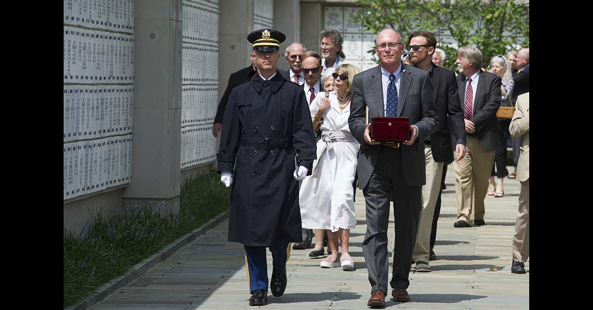 The remains of longtime Associated Press journalist Richard Pyle are carried by Arlington National Cemetery representative Jeffrey Aaron, right, in the columbarium where Pyle will be interred, with military honors, at Arlington National Cemetery, Monday, Aug. 20, 2018, in Arlington, Va. (Cliff Owen/AP)