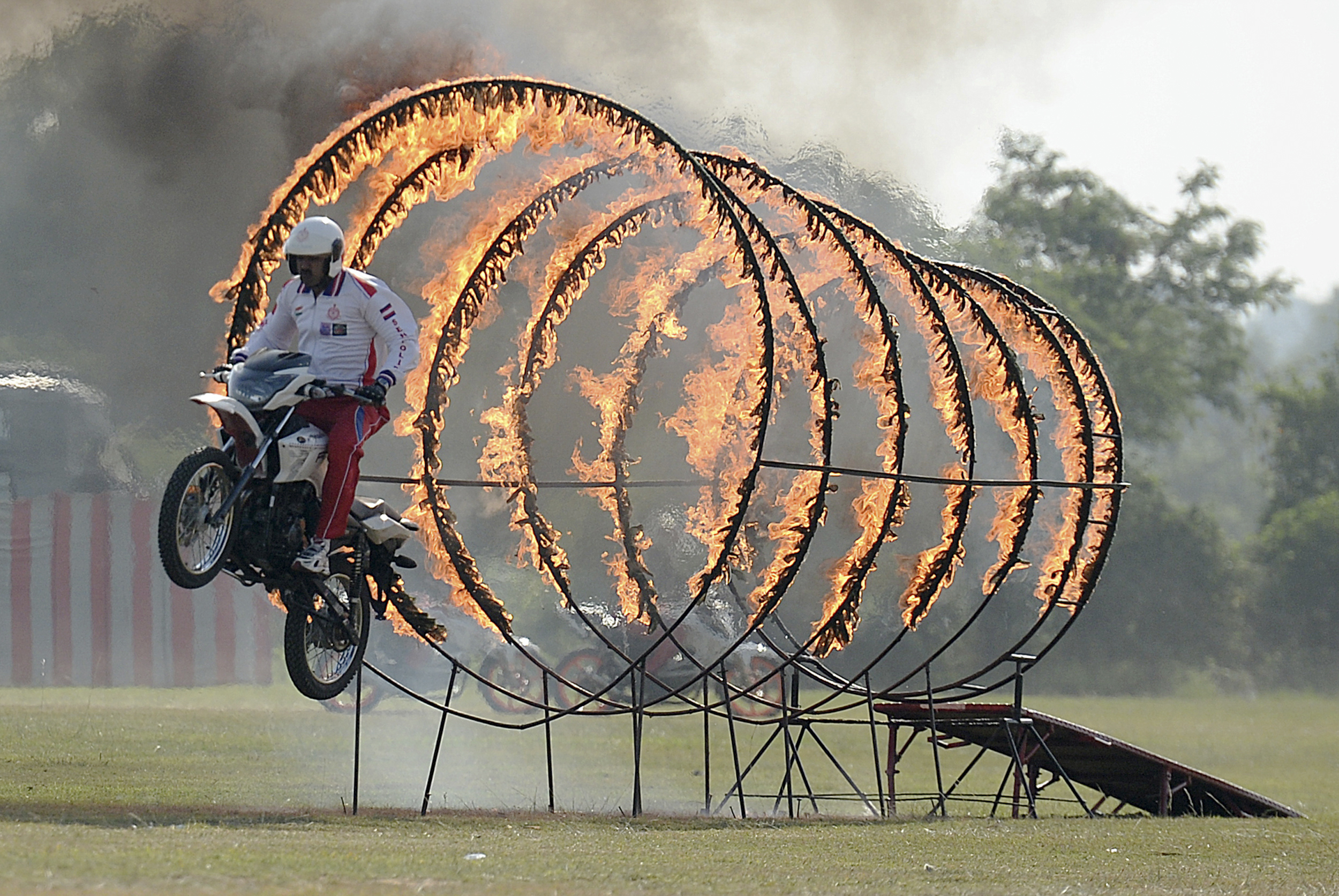An Indian army soldier, a member of the motorcycle display team, performs a stunt during a display at an officer training academy in Chennai on September 7, 2018. (ARUN SANKAR/AFP/Getty Images)