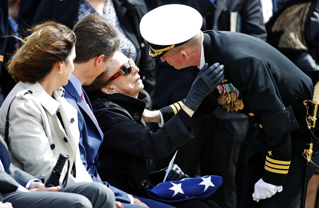 U.S. Navy Cmdr. Nathan Scherry, commanding officer, precommissioning unit, Thomas Hudner, right, gives condolences to Georgea Hudner, during burial services for her husband Capt. Thomas J. Hudner Jr., a naval aviator and Medal of Honor recipient from Concord, Mass., at Arlington National Cemetery Wednesday, April 4, 2018 in Arlington, Va. Hudner earned the Medal of Honor for his actions in the Battle of the Chosin Reservoir during the Korean War.(Alex Brandon/AP)