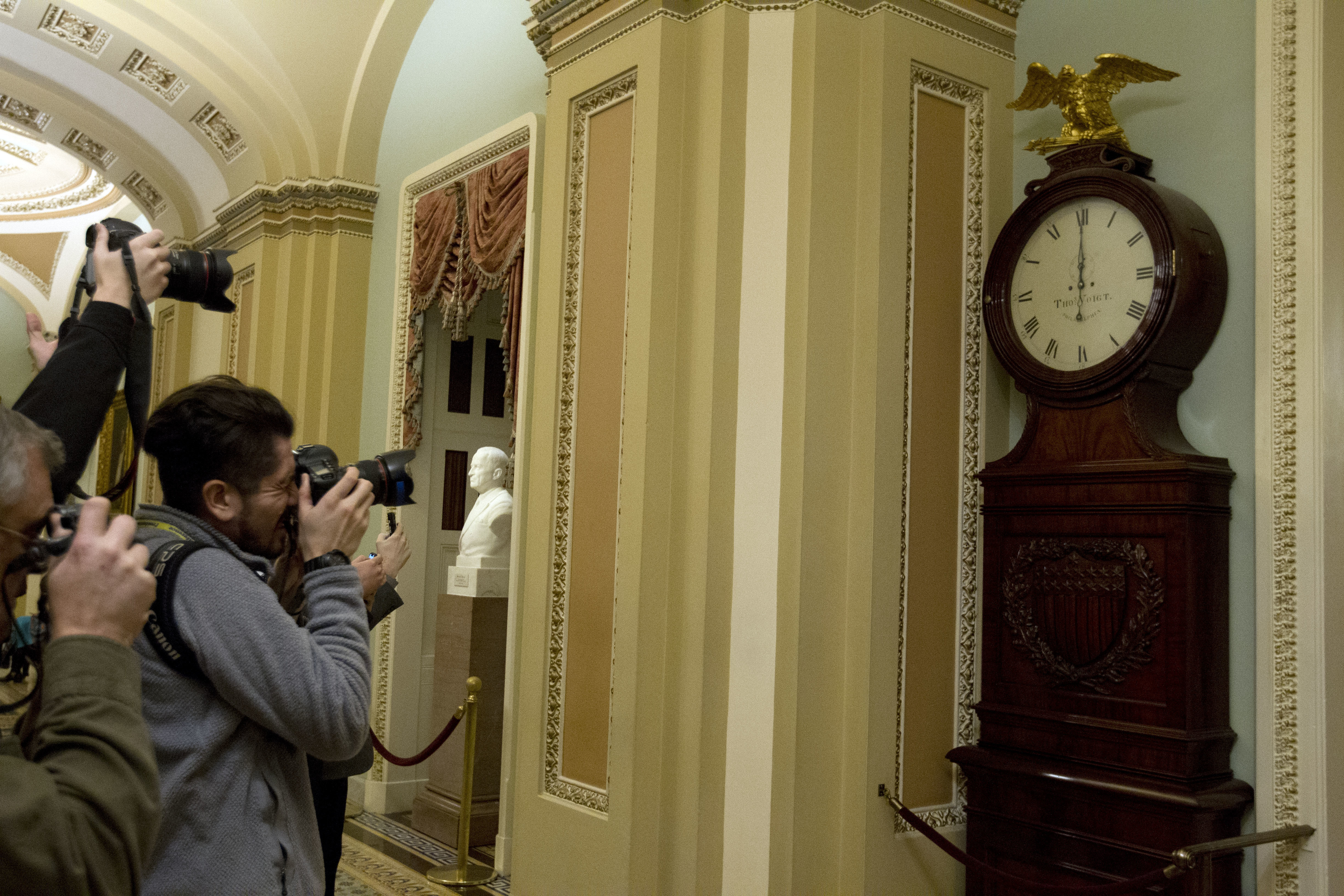 Photographers take a picture of the Ohio Clock outside the Senate chamber shortly after midnight on Jan. 20, 2018 -- the start of the three-day government shutdown. Lawmakers could face a similar spending impasse next week. (Jose Luis Magana/AP)
