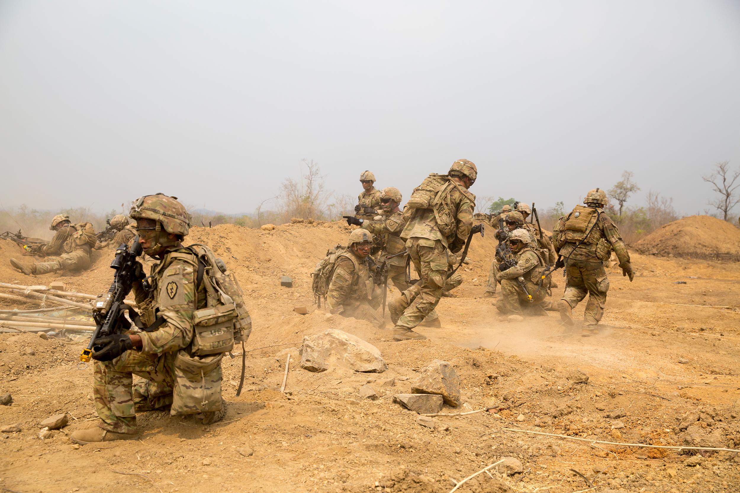 U.S. Army soldiers with 25th Infantry Division, 3rd Squadron, 4th Cavalry Troop, crouch behind a dirt berm after a Bangalore torpedo explosion on March 2, 2020, while preparing for a combined arms live fire exercise during Exercise Cobra Gold 2020 at Ban Dan Lan Hoi, Kingdom of Thailand. (Lance Cpl. Kaleb Martin/Marine Corps)