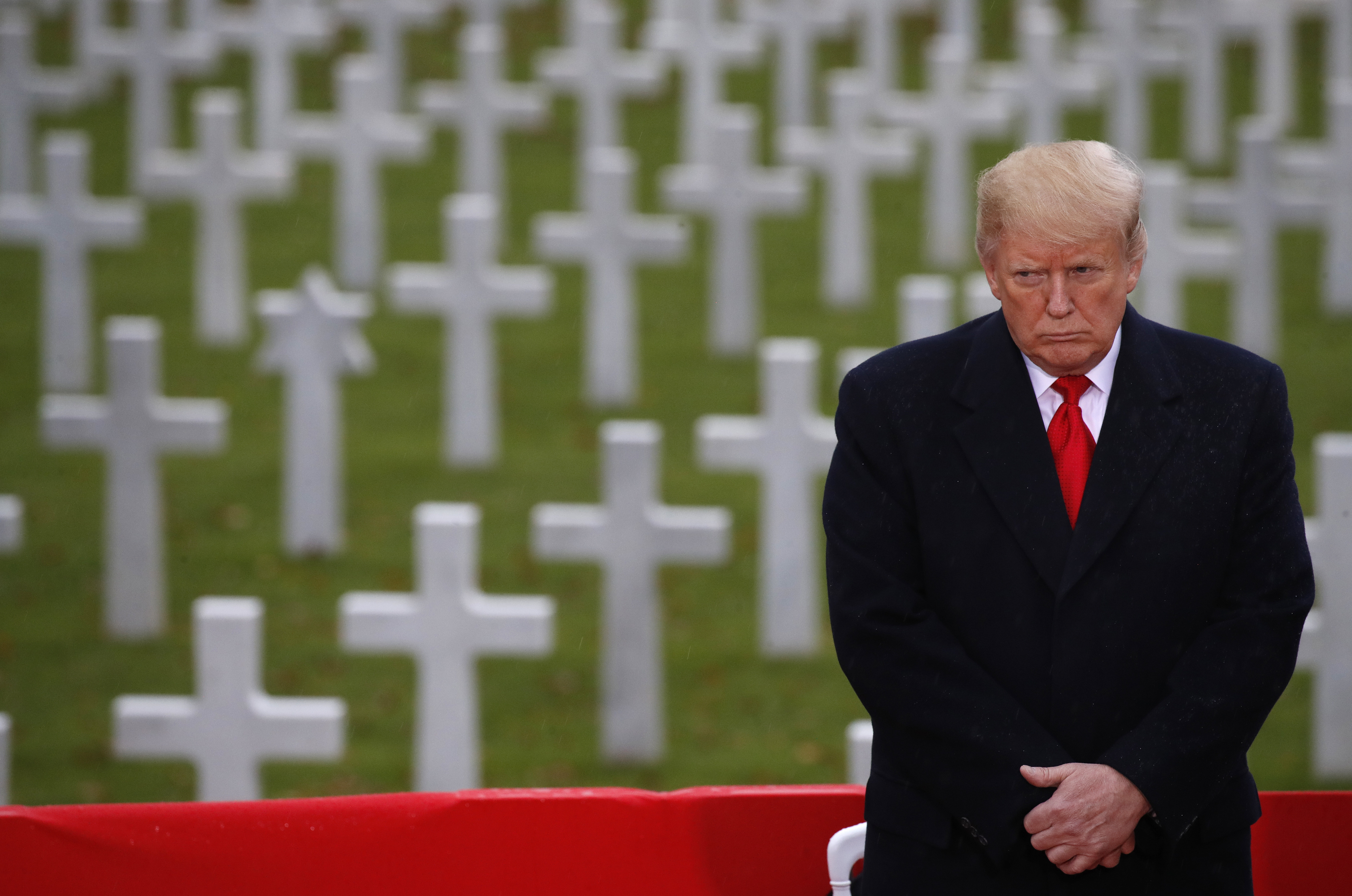 President Donald Trump stands in front of headstones during an American Commemoration Ceremony on Nov. 11, 2018, at Suresnes American Cemetery near Paris. (Jacquelyn Martin/AP)
