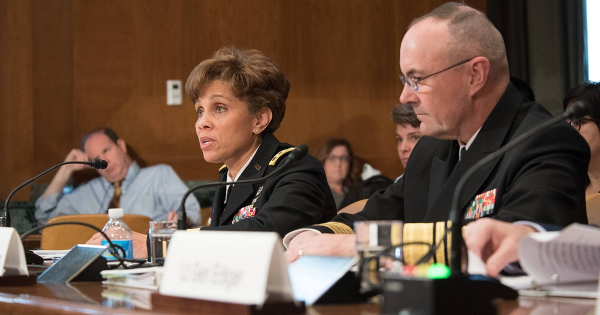 Surgeons general Army Lt. Gen. (Dr.) Nadja West, left,