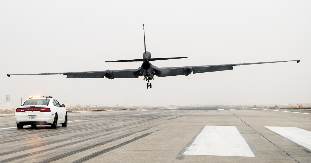 A U-2 Dragon Lady pilot with the 99th Expeditionary Reconnaissance Squadron drives a high-performance chase car on the runway to catch a U-2 performing a low-flight touch and go at Al Dhafra Air Base, United Arab Emirates, March 15. While driving the chase cars, U-2 pilots aid the pilot flying the Dragon Lady by radioing altitude and runway alignments during take-offs and landings. (Senior Airman Gracie Lee/Air Force)