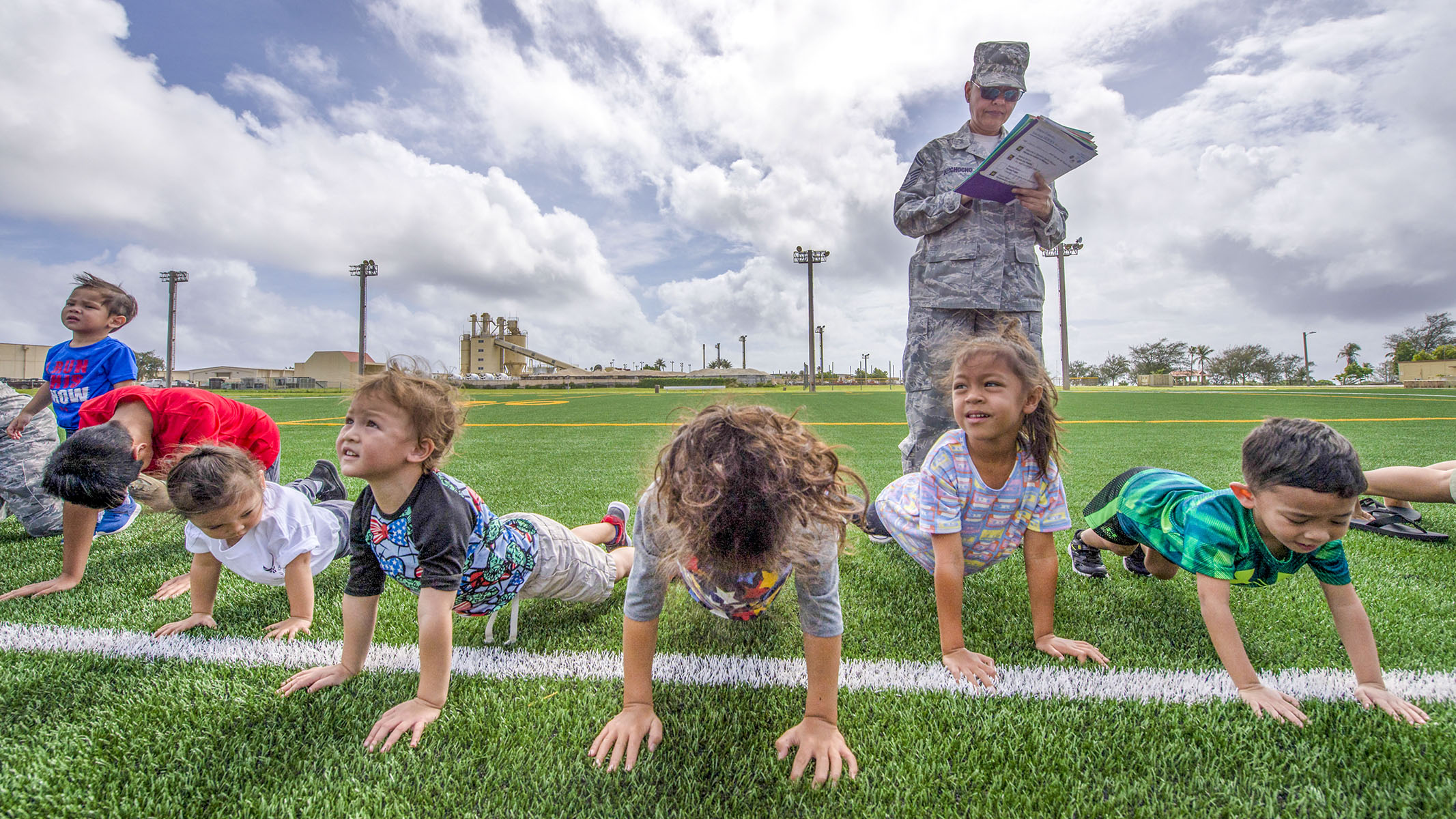 Air Force kids learn their parents' deployment process at Andersen Air Force Base, Guam. Military families shared a playful version of military processing to introduce children of deploying reservists to what their parents will experience when preparing for their deployment. (Staff Sgt. Alexander W. Riedel/Air Force)