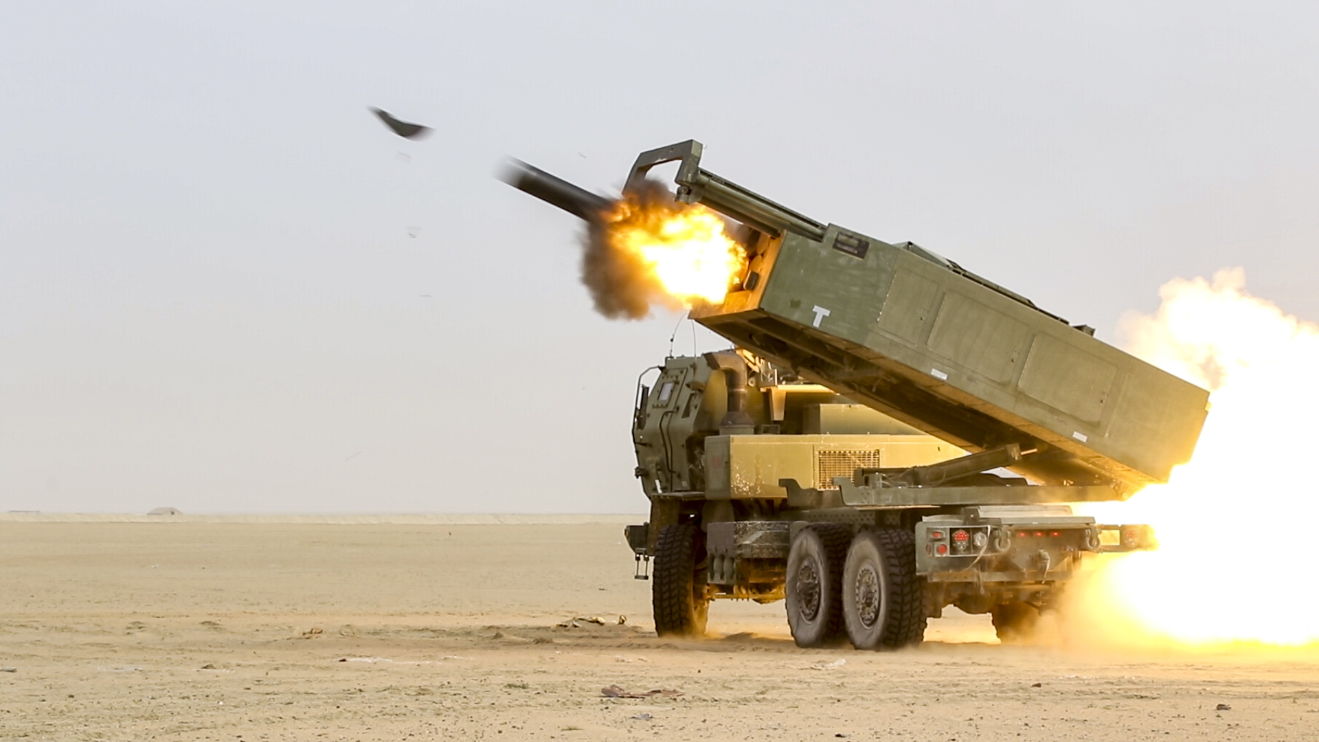 Soldiers assigned to the 65th Field Artillery Brigade fire a High Mobility Artillery Rocket System (HIMARS) during a joint live-fire exercise with the Kuwait Land Forces, near Camp Buehring, Kuwait. (Sgt. Bill Boecker/Army)