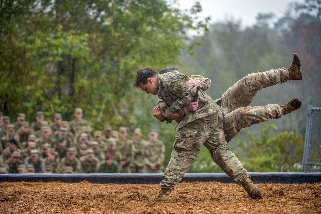 FORT BENNING, Ga. (Oct. 26, 2018) -- Two soldiers with the Airborne and Ranger Training Brigade demonstrate hand-to-hand combat maneuvers during the Rangers In Action demonstration preceding a Ranger Course graduation on Oct. 26, 2018, at Fort Benning, Ga. (Patrick A. Albright/Army)
