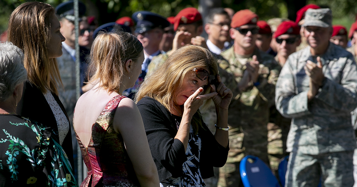 Valerie Nessel, spouse of U.S. Air Force Tech. Sgt. John Chapman, Brianna and Madison Chapman, daughters of Chapman, wipes away tears during a Medal of Honor unveiling ceremony at the Air Force Memorial for Air Force combat controller Technical Sgt. John Chapman, who was posthumously awarded the MOH on Wednesday. (Alan Lessig/Staff)