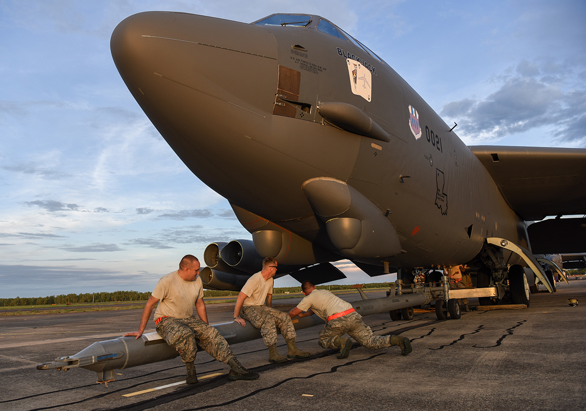 U.S. Air Force members from the 96th Expeditionary Aircraft Maintenance Unit shake a tow bar to maneuver it into place on a B-52 Stratofortress bomber during exercise Lightning Focus at Royal Australian Air Force Base Darwin, Australia, Nov. 29, 2018. (Senior Airman Christopher Quail/Air Force)