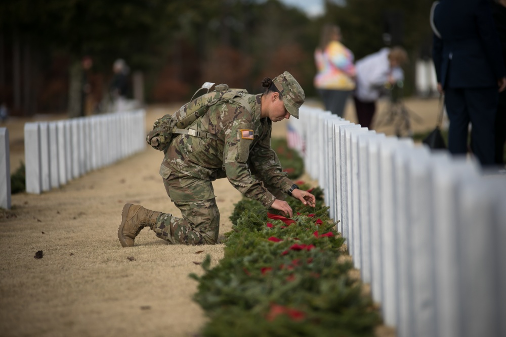 A soldier places a wreath next to a marker at the Fort Jackson National Cemetery in South Carolina on Dec. 14, 2019, during a Wreaths Across America event. (Saskia Gabriel/Fort Jackson)