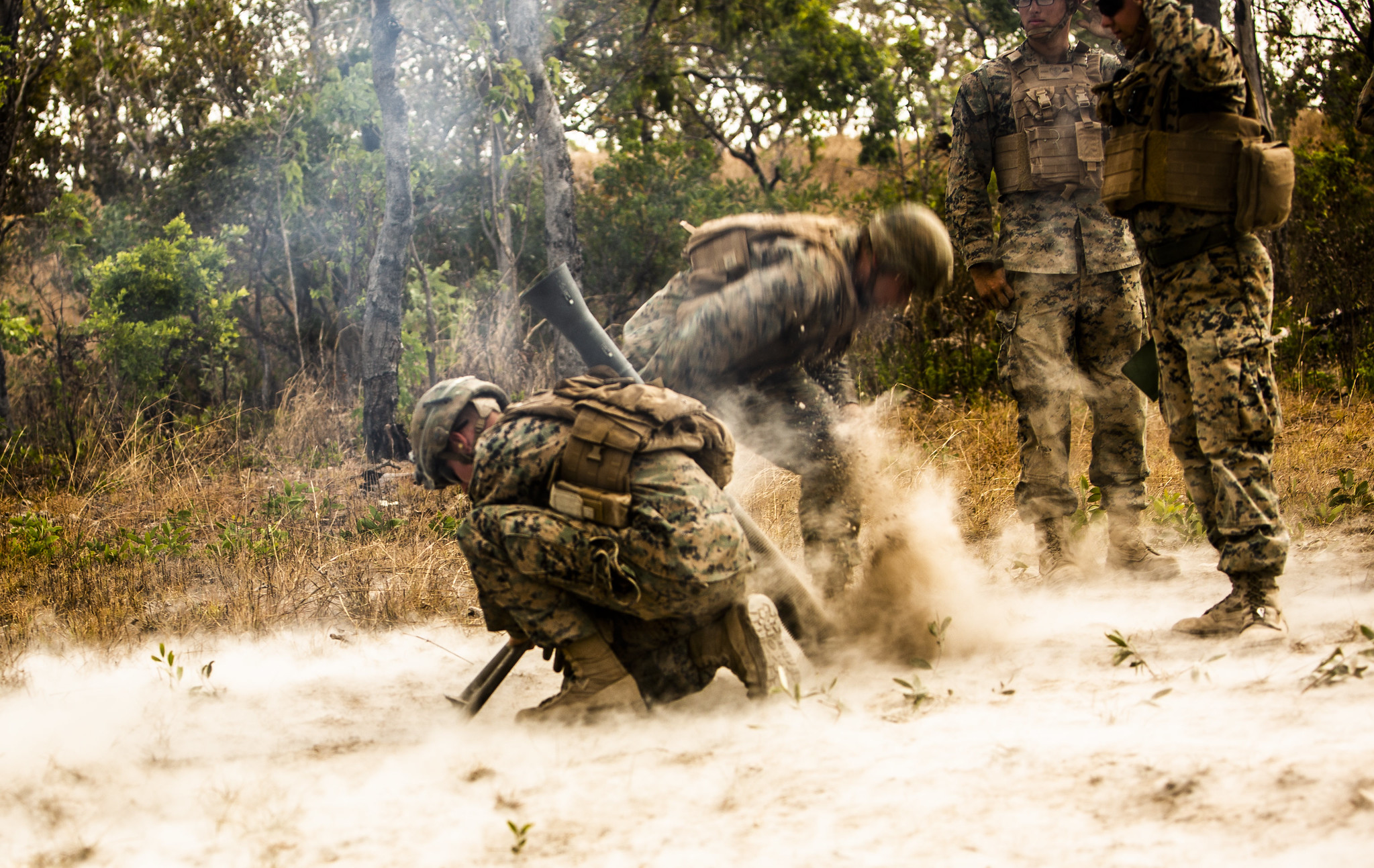 Marines with 3rd Battalion, 3rd Marine Regiment, a part of Marine Rotational Force - Darwin, fire an M252 81mm extended range mortar system during a fire support coordination exercise at Mount Bundey Training Area, Australia, Aug. 9, 2019. (Lance Cpl. Nicholas Filca/Marine Corps)