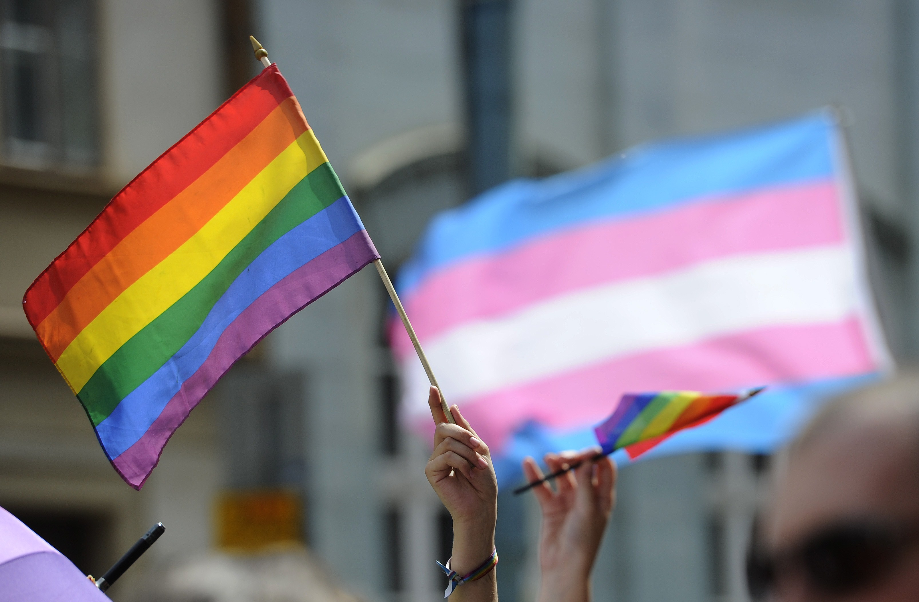 People hold up rainbow flags as they demonstrate during the lesbian, gay, bisexual and transgender (LGBT) Rainbow Pride Parade in Bratislava, Slovakia, on June 28, 2014. A Military Times/IVMF poll conducted late last year showed concerns among troops about changes in the military's policies towards transgender individuals. (Samuel Kubani/Getty Images)