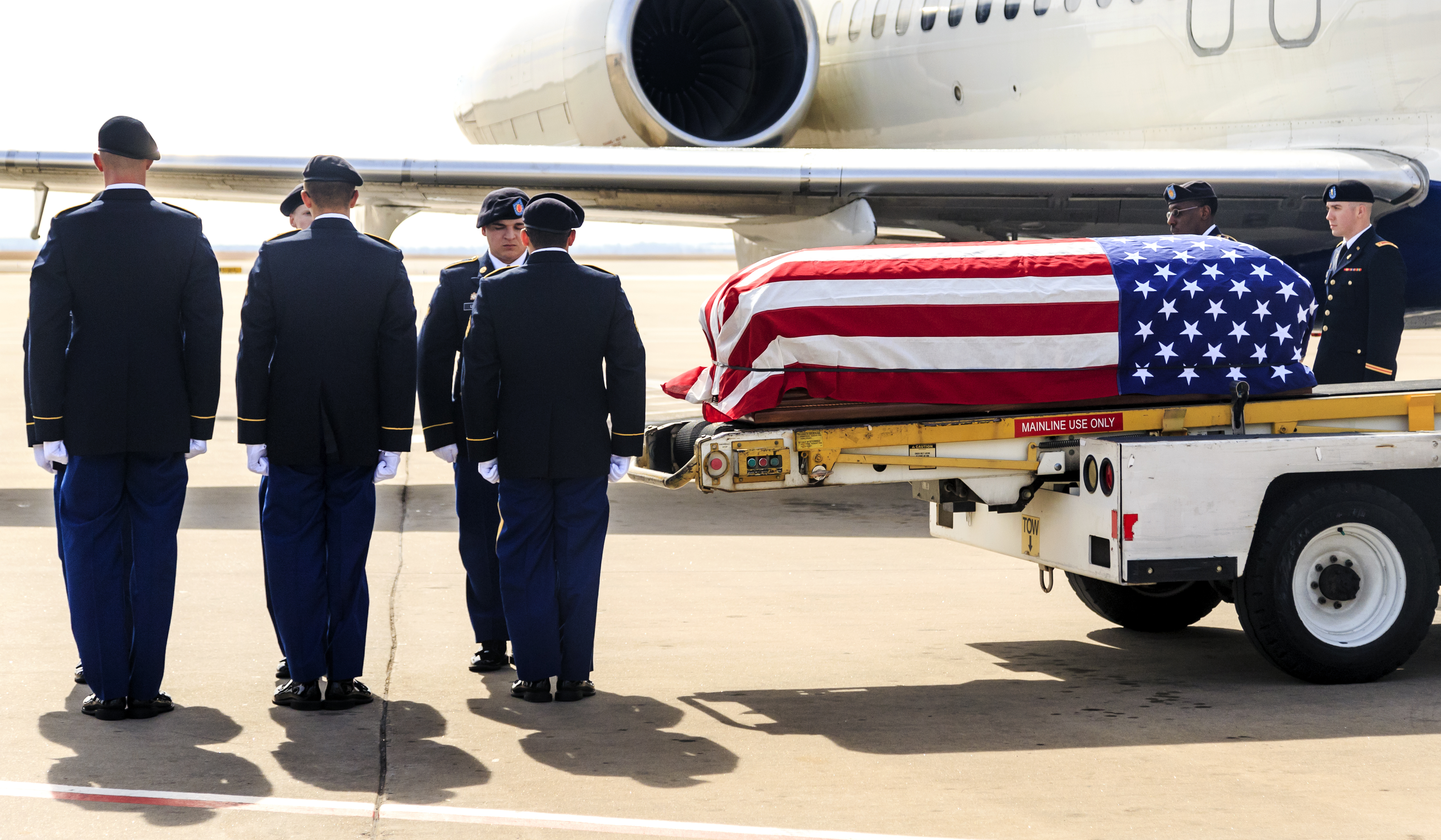 In this Wednesday, Feb. 14, 2018, photo, the remains of WW II and Korean War Army veteran Alfred Bensinger Jr. are unloaded off of a Delta Airlines plane at Will Rogers World Airport in Oklahoma City, Okla. The remains of the soldier from Oklahoma City were returned to his home state nearly 70 years after he was taken prisoner during the Korean War. (Chris Landsberger/The Oklahoman via AP)