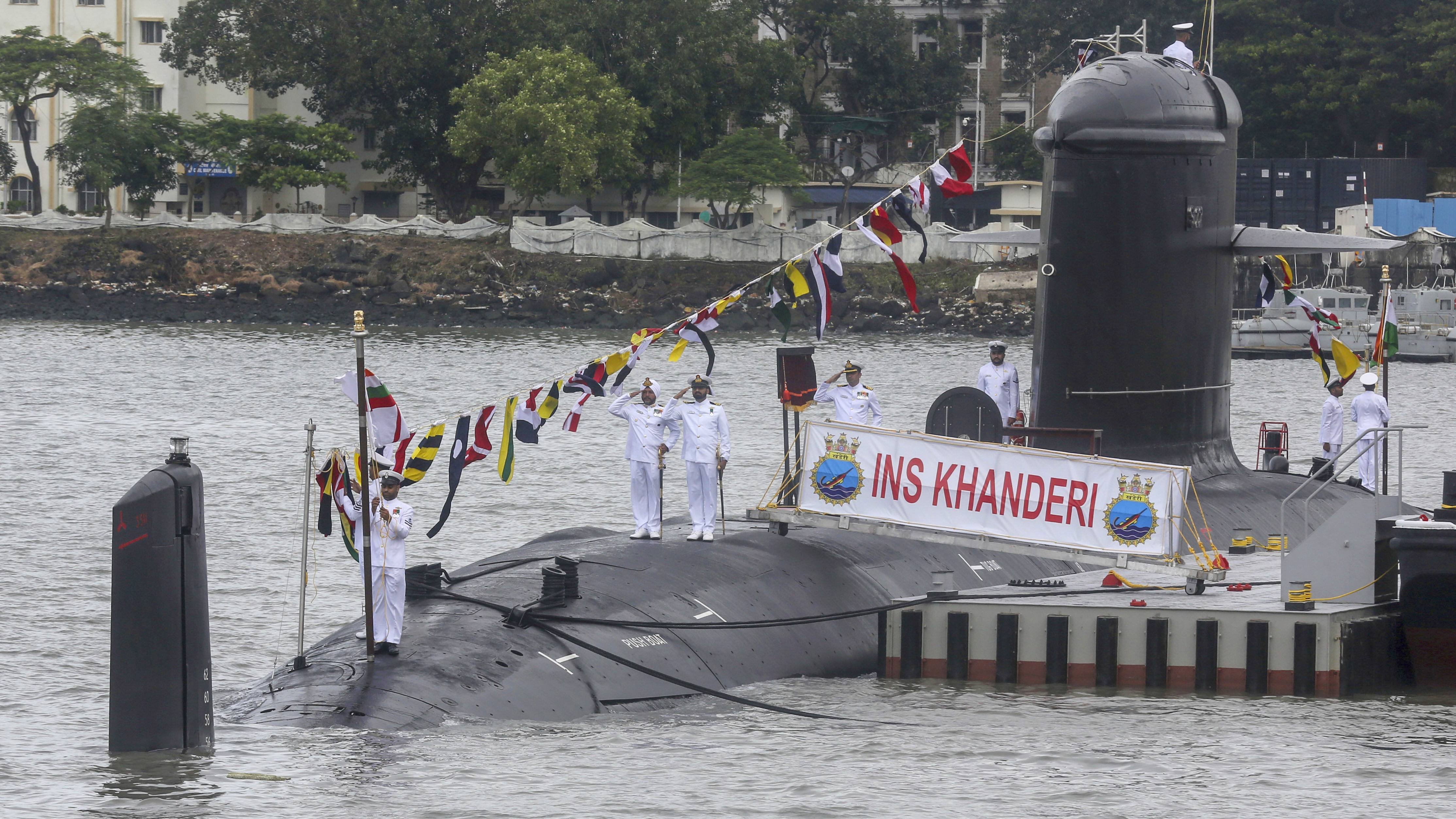 Indian navy sailors salute during the commissioning ceremony of the INS Khanderi, India's second Scorpene-class submarine, in Mumbai, India, Saturday, Sept. 28, 2019.. (AP Photo/Rafiq Maqbool)