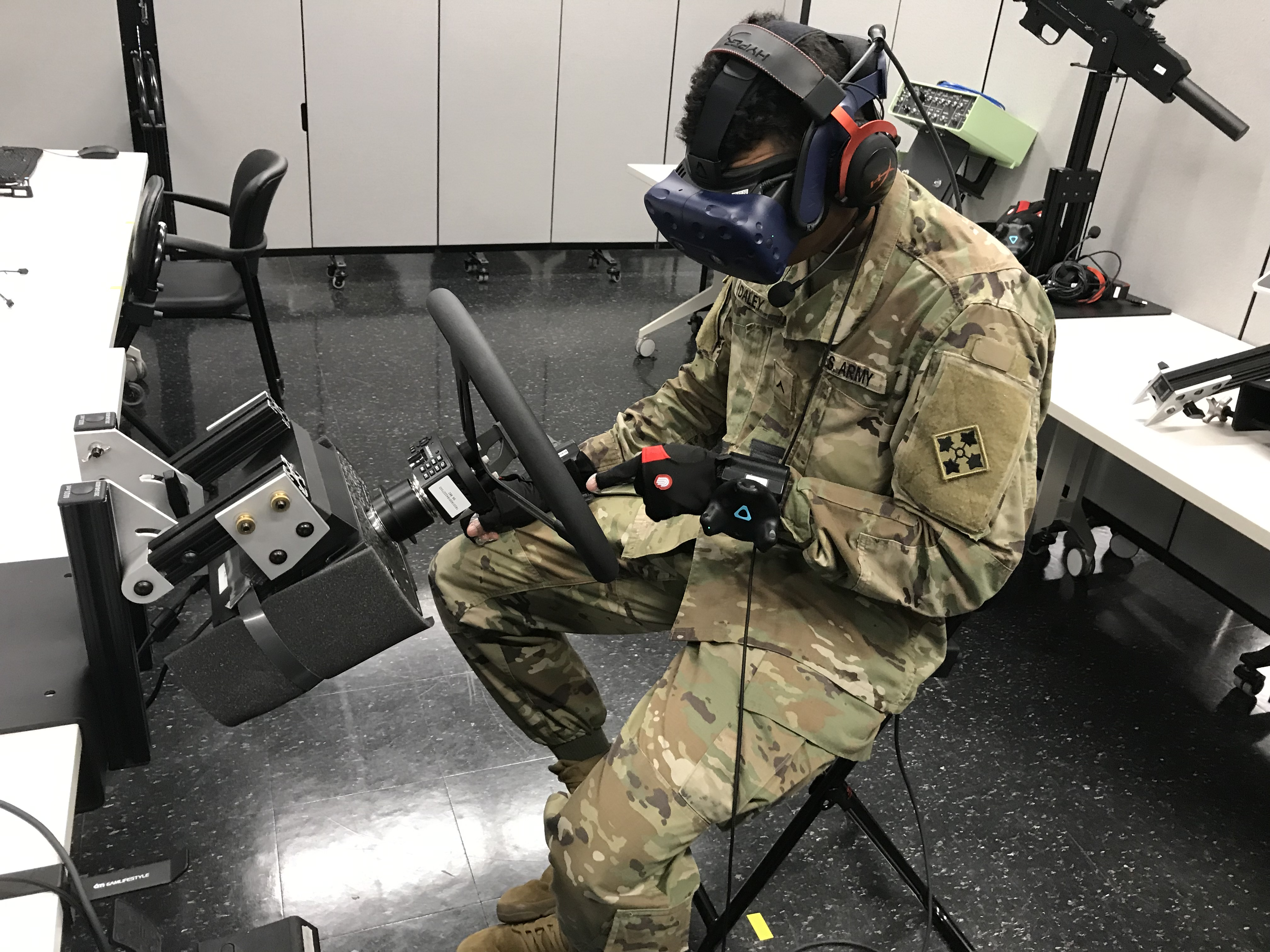 Soldier at Fort Riley, Kansas, tries out the Army's early prototype of a Reconfigurable Virtual Collective Trainer. (Army)