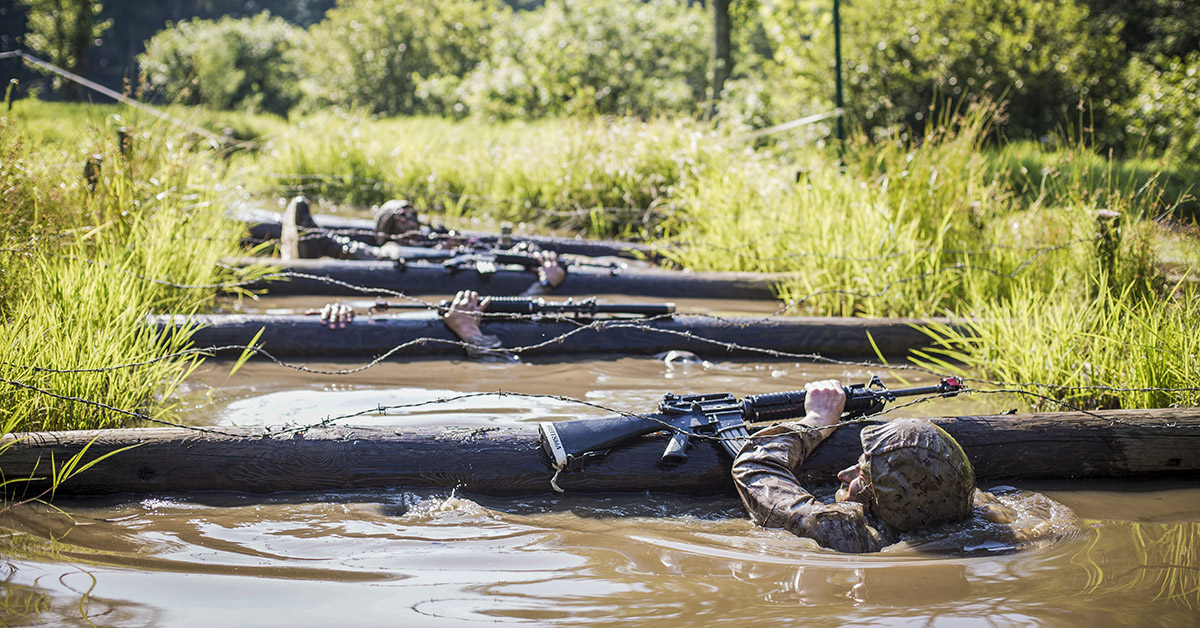 U.S. Marine Corps Officer Candidates participate in the combat course at the Officer Candidates School, Marine Corps Base Quantico, Va., June 18, 2018. Candidates must go through three months of intensive training to evaluate and screen individuals for the leadership, moral, mental, and physical qualities required for commissioning as a U.S. Marine Corps officer. (Staff Sgt. Melissa Marnell/Marines)