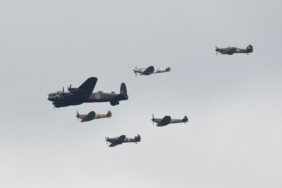 A World War II Lancaster bomber and Spitfires fly in formation on the centenary of the formation of the British Royal Air Force RAF. (Oli Scarff/AFP via Getty Images)