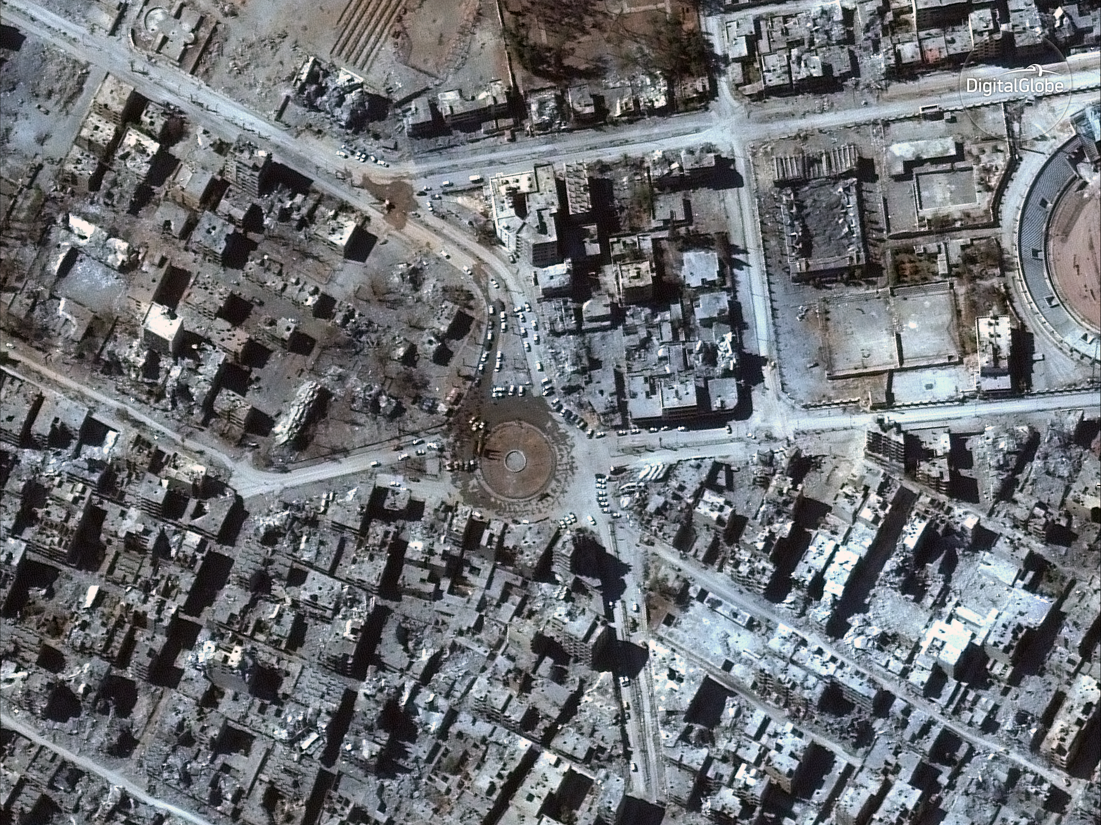 Satellite leaders say the government needs to move faster in weighing changes to industry regulations. Companies such as Maxar, formerly known as DigitalGlobe, produce images such as the one above showing Syrian forces gathered in iconic Al-Naim square surrounded by the ruins of destroyed buildings. (satellite image DigitalGlobe)