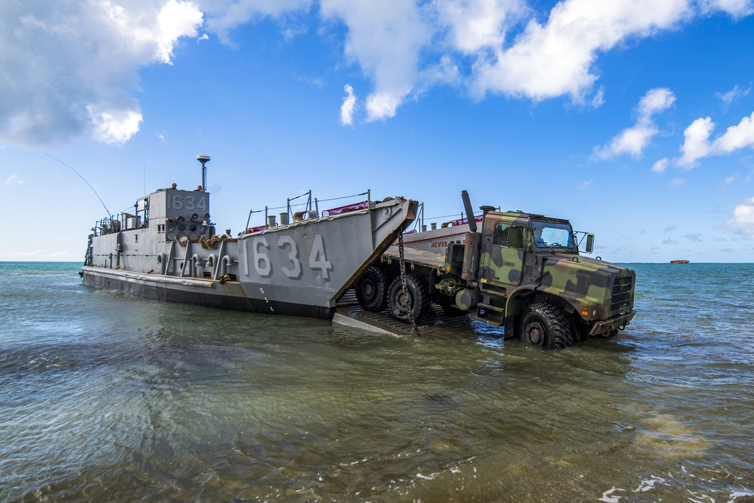 A U.S. Army light medium tactical vehicle assigned to the 9th Mission Support Command, Army Reserves, Honolulu, is driven on a U.S. Naval Landing Craft Utility operating out of the USS Ashland (LSD 48) during beach-front loading and unloading of vehicles on Saipan, Commonwealth of the Northern Mariana Islands, Nov. 12, 2018, as part of the Super Typhoon Yutu relief effort. (Tech. Sgt. Christopher Ruano/Air Force)