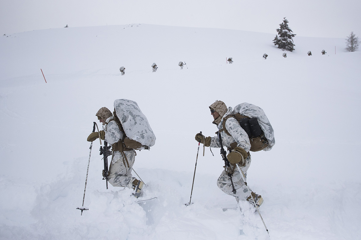 A group of U.S. Marines walk along a snow-covered trail during advanced cold-weather training at the Marine Corps Mountain Warfare Training Center Sunday, Feb. 10, 2019, in Bridgeport, Calif. After 17 years of war against Taliban and al-Qaida-linked insurgents, the military is shifting its focus to better prepare for great-power competition with Russia and China, and against unpredictable foes such as North Korea and Iran. (Jae C. Hong/AP)