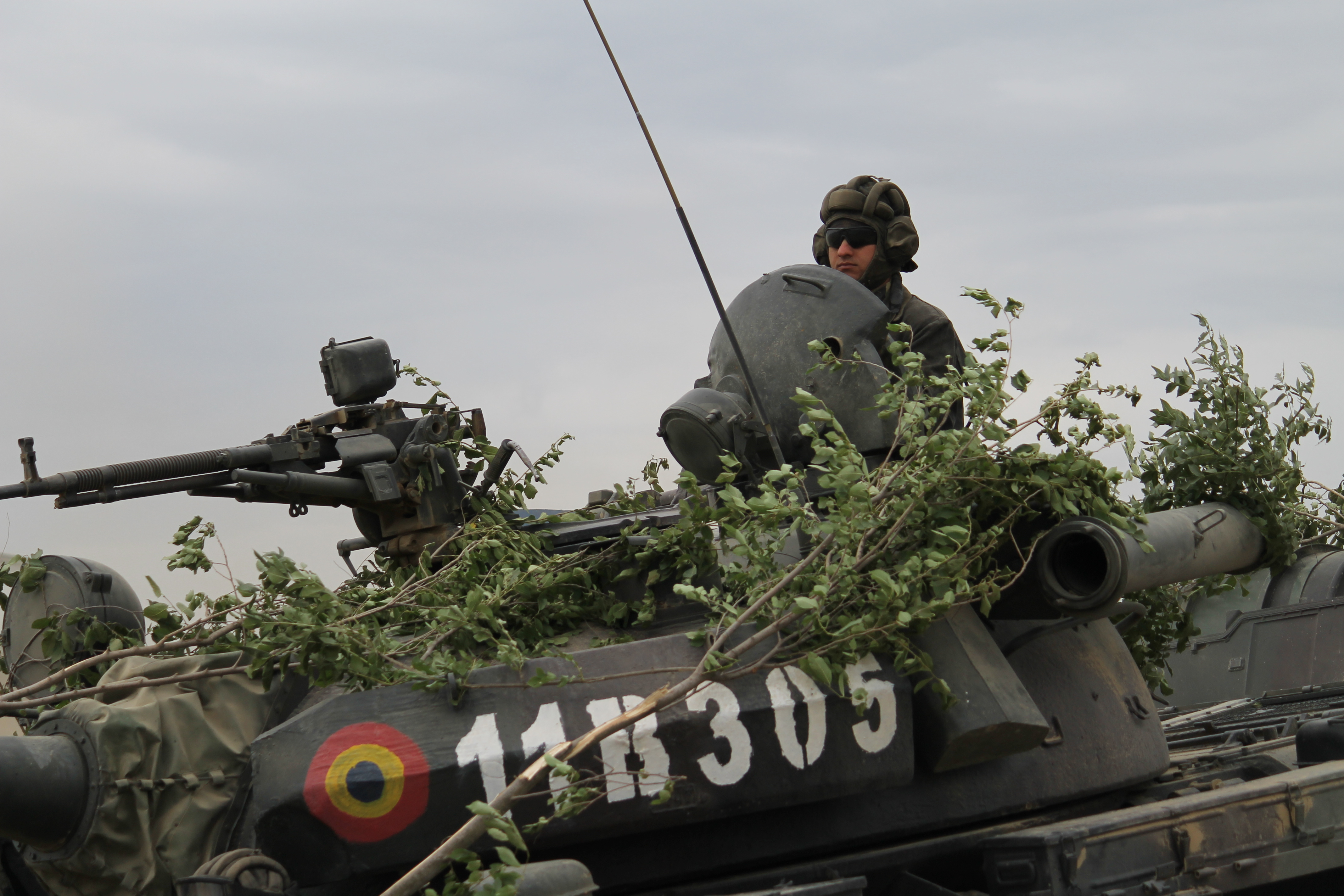 A Romanian soldier rides in a T-85 main battle tank across the bridge during the river crossing. (Jen Judson/Staff)
