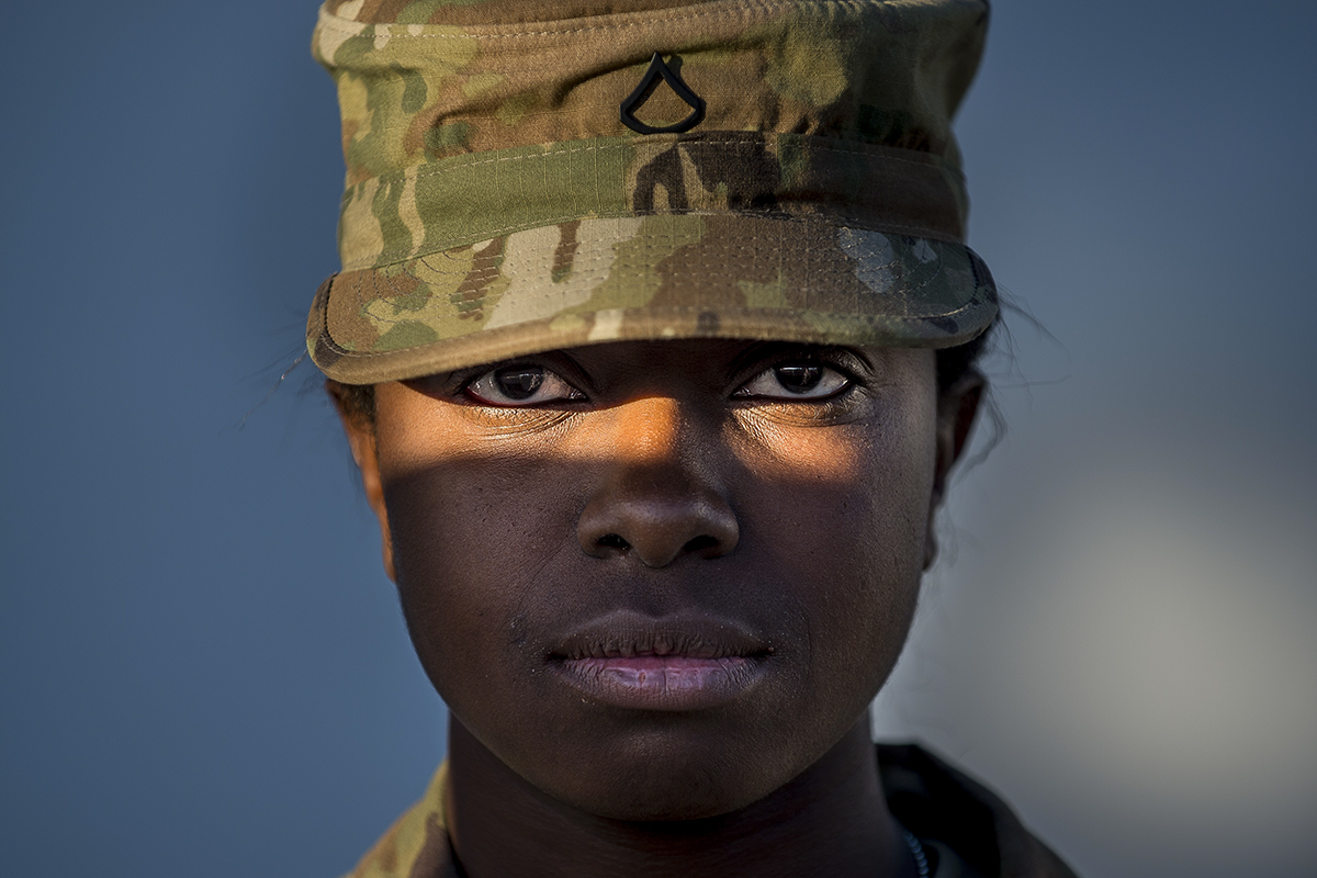 Pfc. Alexis Jones, a U.S. Army Reserve horizontal construction engineer with the 160th Military Police Battalion, headquartered in Tallahassee, Florida, from Winter Garden, Florida, looks into the camera for a sun-lit portrait during the 200th Military Police Command's Best Warrior Competition held at Fort Hunter Liggett, California, April 19, 2018. During the competition, Soldiers were tested both physically and mentally in events that include the Army Physical Fitness Test, land navigation, obstacle course, ruck marching, weapon qualification, Army Warrior Tasks, reflexive fire, written exams and the Army appearance board. Soldiers from the U.S. Army Reserve Legal Command also participated in the competition. The winning Soldiers will move on to compete in the U.S. Army Reserve Command competition later this year. (U.S. Army photo by Master Sgt. Michel Sauret)