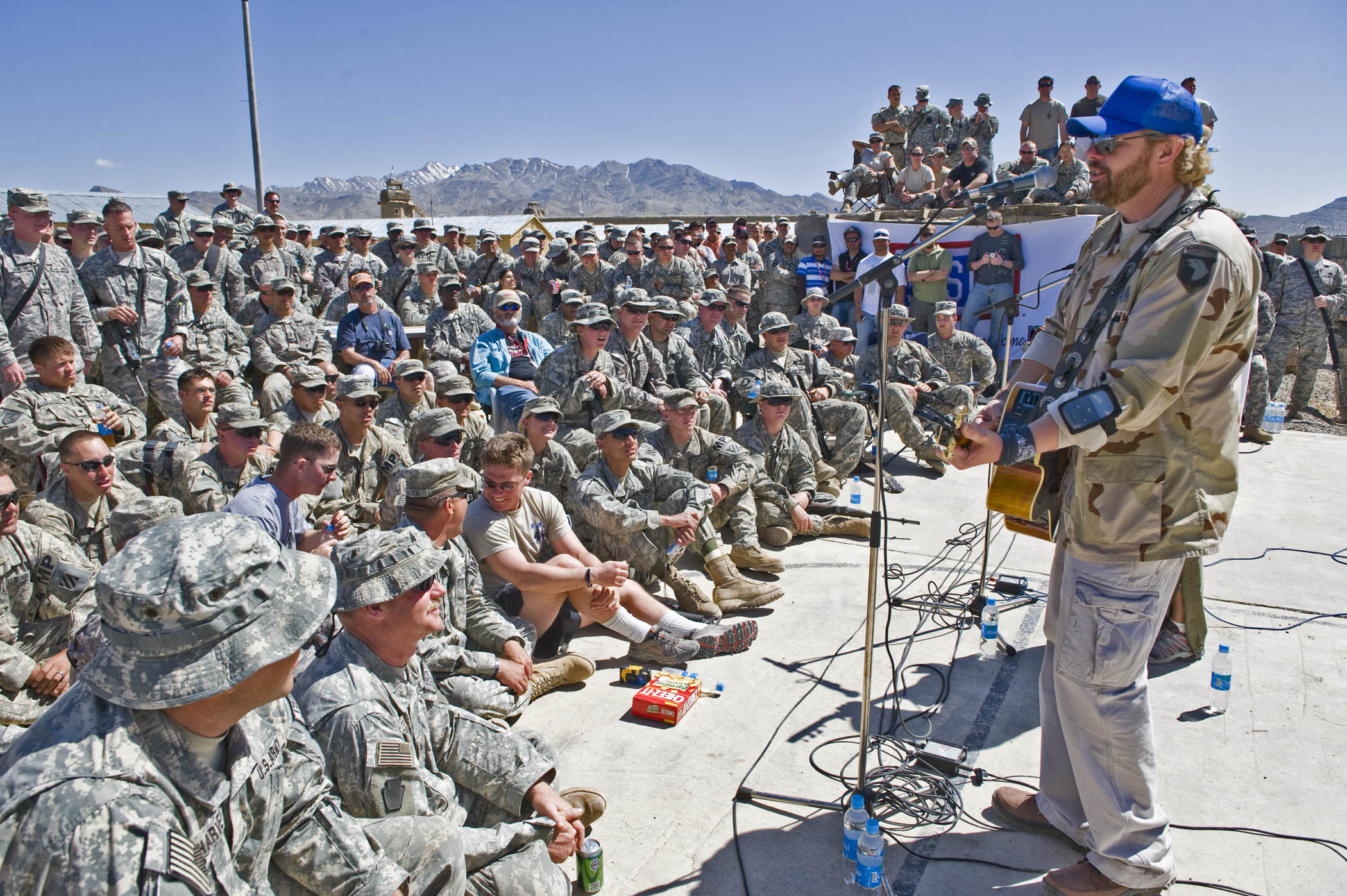 Toby Keith in Afghanistan putting on shows at Forward Operating Bases in 2008. Here at FOB Gardez, where the soldiers were able to get up really close in this acoustics show. (Dave Gatley/USO)