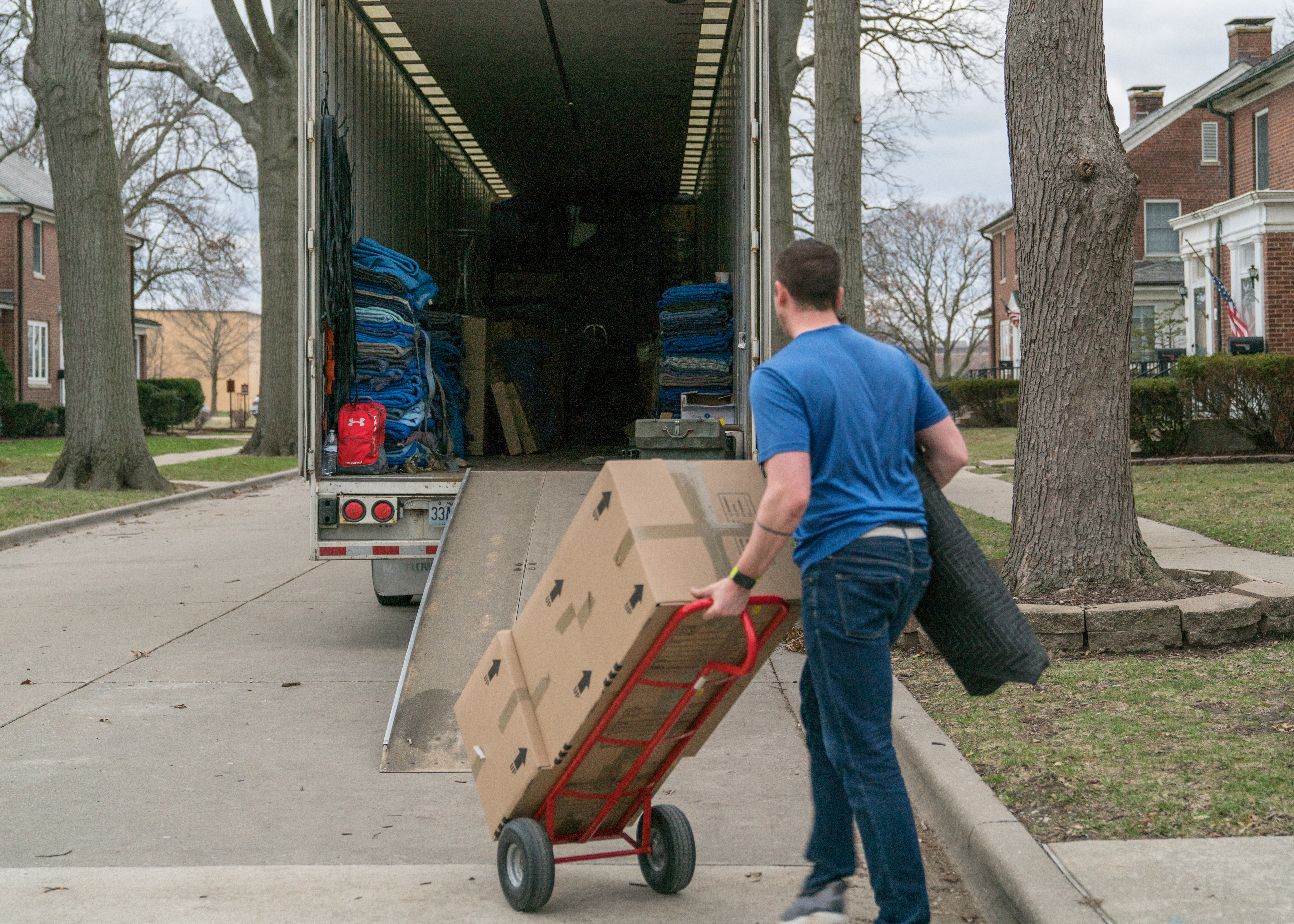 A moving company employee loads a moving truck with a service member's household goods during the permanent change of station peak-season at Scott Air Force Base, Ill. in 2018. (Air Force Staff Sgt. Oz Suguitan/TRANSCOM)