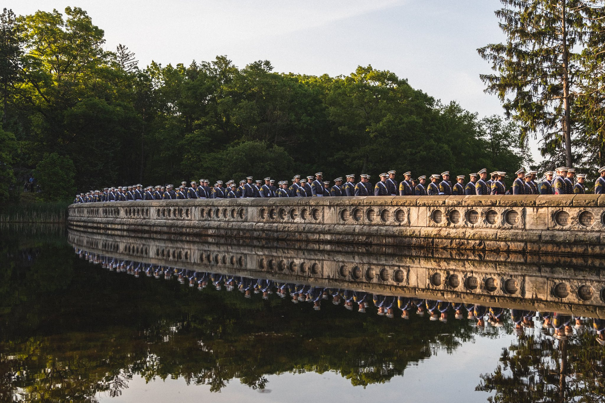 First class cadets walk across Luck Reservoir on their way to graduation May 25, 2019. (Cadet Alex Gudenkauf/Army)