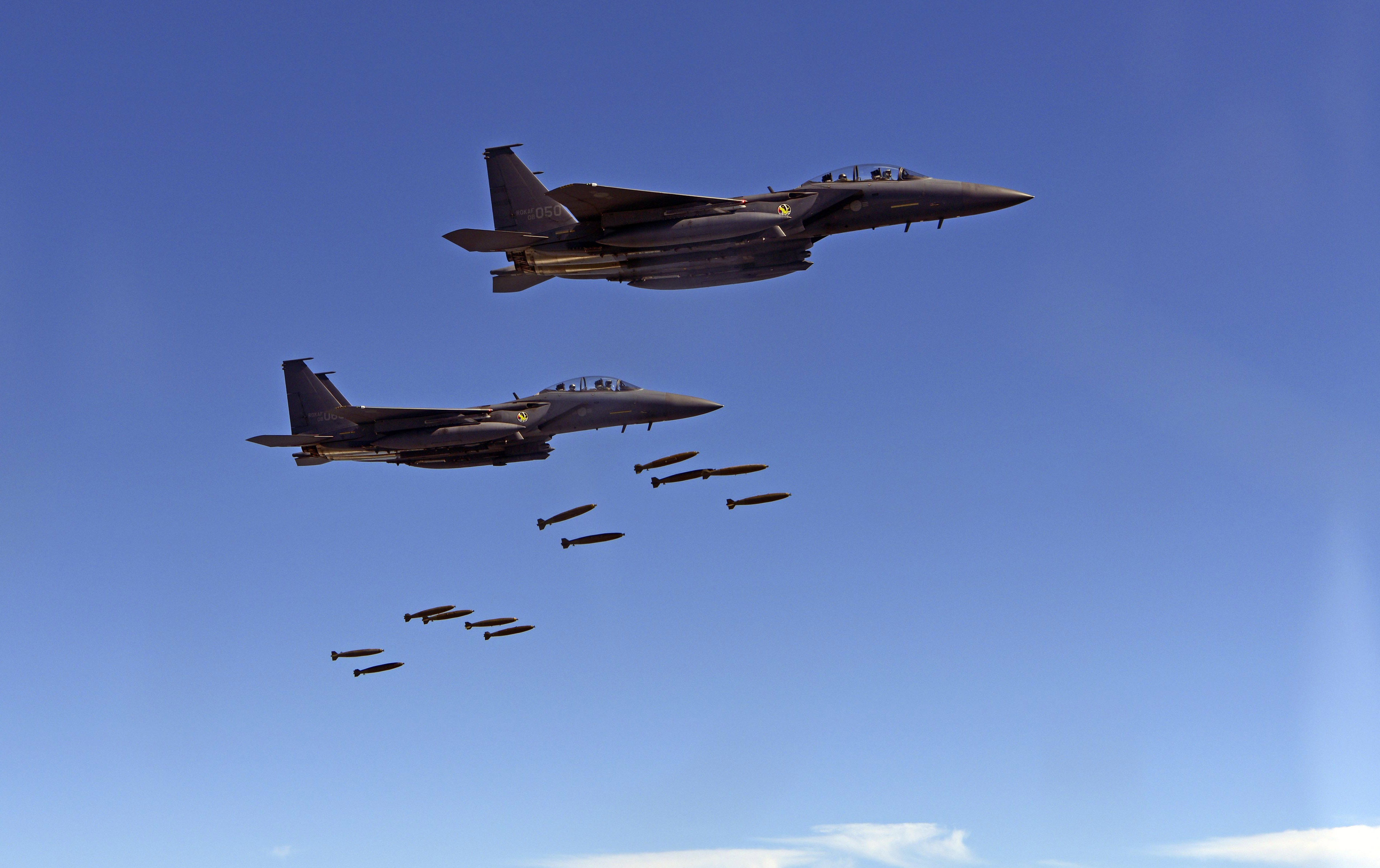 South Korean F-15K fighters drop munitions over Pilsung Range during operations alongside U.S. F-35B stealth fighters and B-1B Lancer bombers. South Korea Defense Ministry via AP)