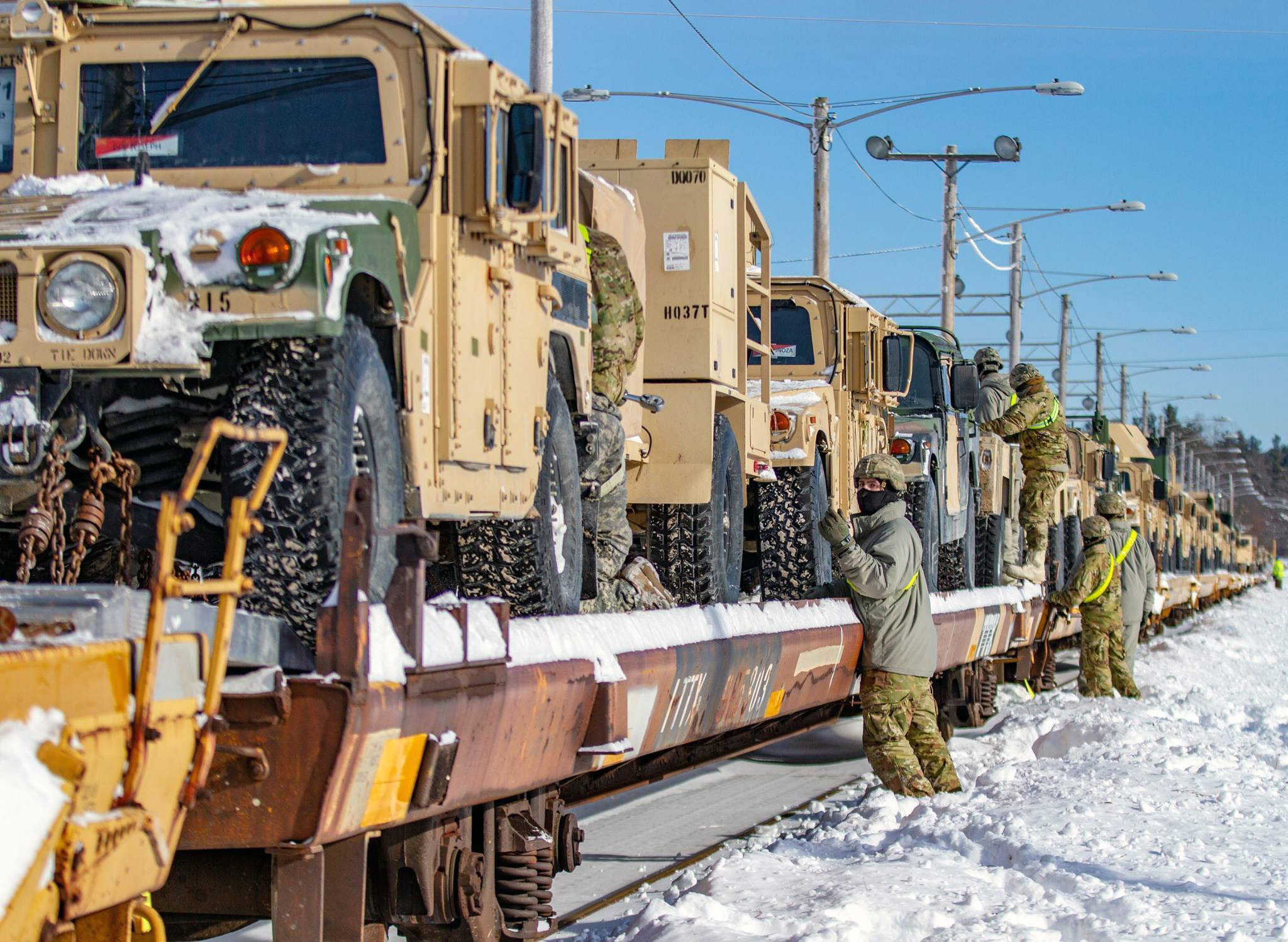 Soldiers from 10th Mountain Division take the final steps to make sure the vehicles on the railhead are ready for transport to Fort Polk, La., on Feb. 14, 2019. (Army)