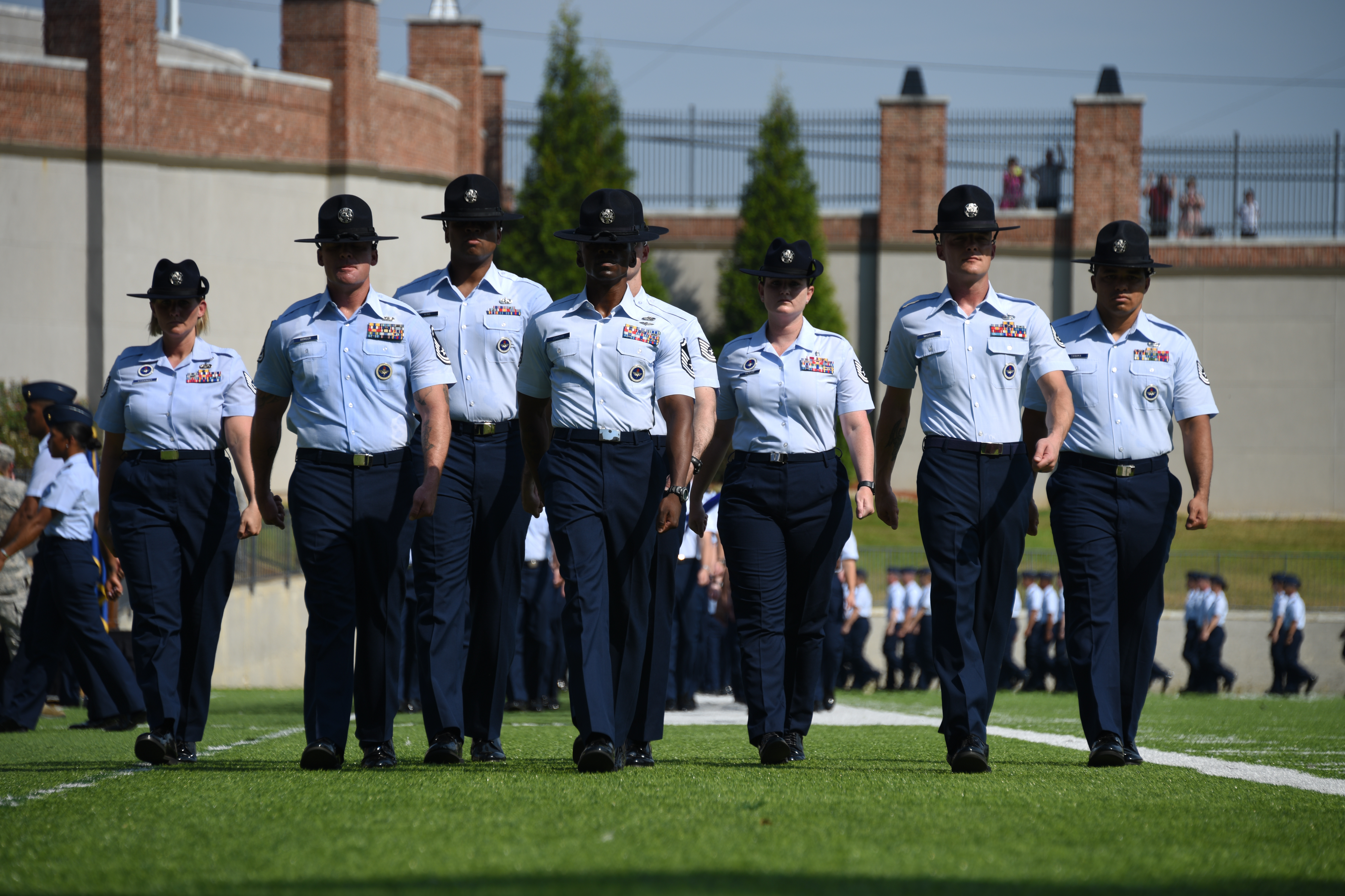 """Military training instructors from Officer Training School """"Godzilla"""" class 19-07 march forward during a graduation ceremony Sept. 27, 2019, Montgomery, Alabama. Class 19-07, also known as """"Godzilla Class,"""" spent the last eight weeks taking part in a series of field training and classroom leadership exercises preparing them to become Air Force officers. (Staff Sgt. Quay Drawdy/Air Force)"""