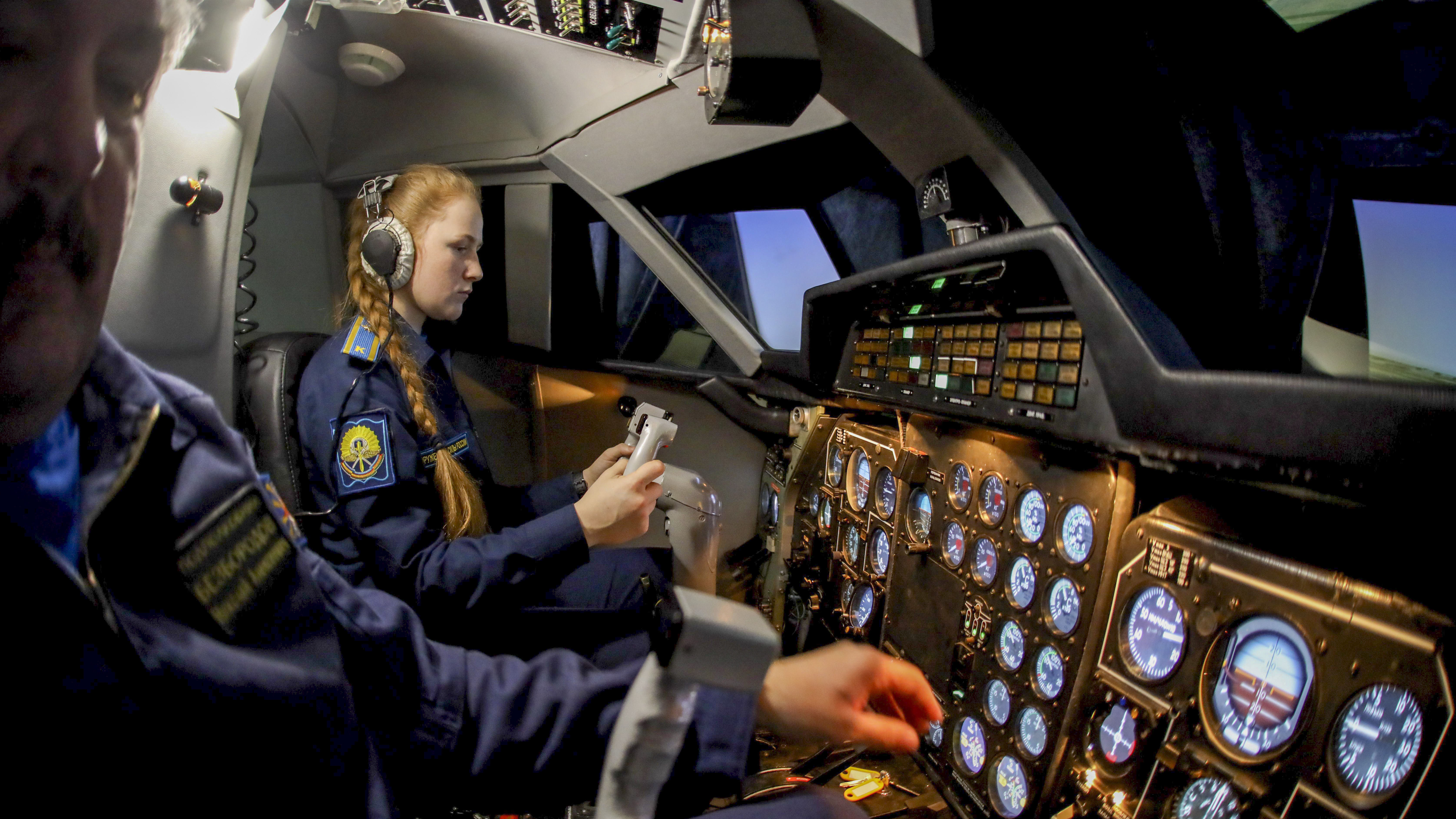 A female cadet sits in an aircraft cockpit simulator during a class at the Krasnodar Higher Military Aviation School in Krasnodar, Russia on March 1, 2019. (VITALY TIMKIV/AFP/Getty Images)