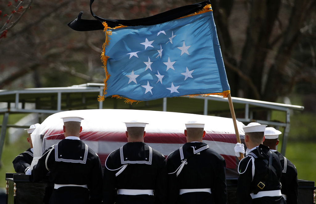 The Medal of Honor flag flies during burial services for Capt. Thomas J. Hudner Jr., a naval aviator and Medal of Honor recipient from Concord, Mass., at Arlington National Cemetery Wednesday, April 4, 2018 in Arlington, Va. Hudner earned the Medal of Honor for his actions in the Battle of the Chosin Reservoir during the Korean War. (Alex Brandon/AP)