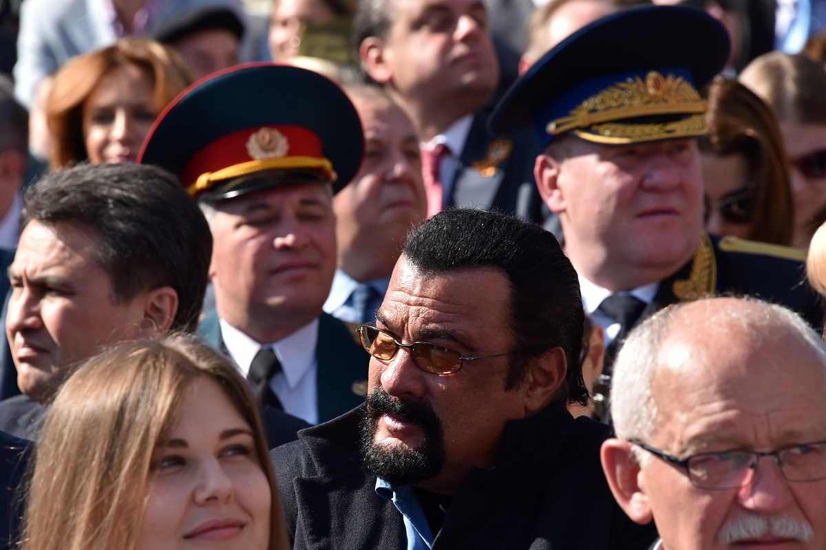 U.S. actor Steven Seagal, center, attends the 2015 Victory Day military parade. He was also present at the 2018 event (Kirill Kudryavtsev/AFP via Getty Images)