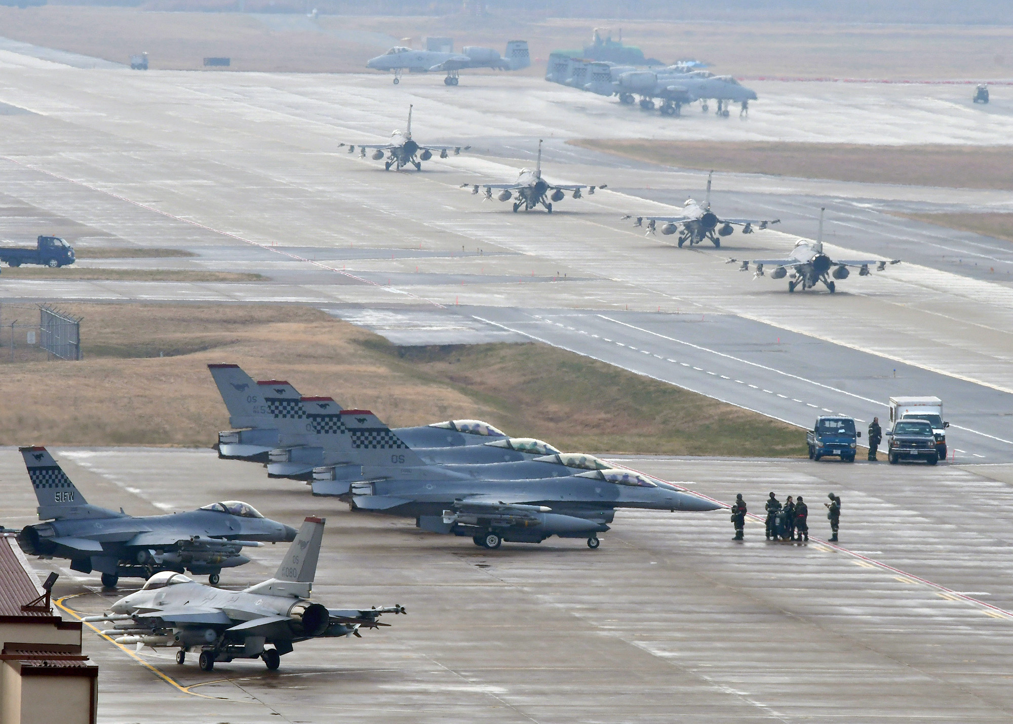 U.S. Air Force F-16 Fighting Falcon fighter aircraft, assigned to the 36th Fighter Squadron, participate in an elephant walk during Exercise Vigilant Ace 18 at Osan Air Base, South Korea on Dec. 3, 2017. (Staff Sgt. Franklin R. Ramos/U.S. Air Force)
