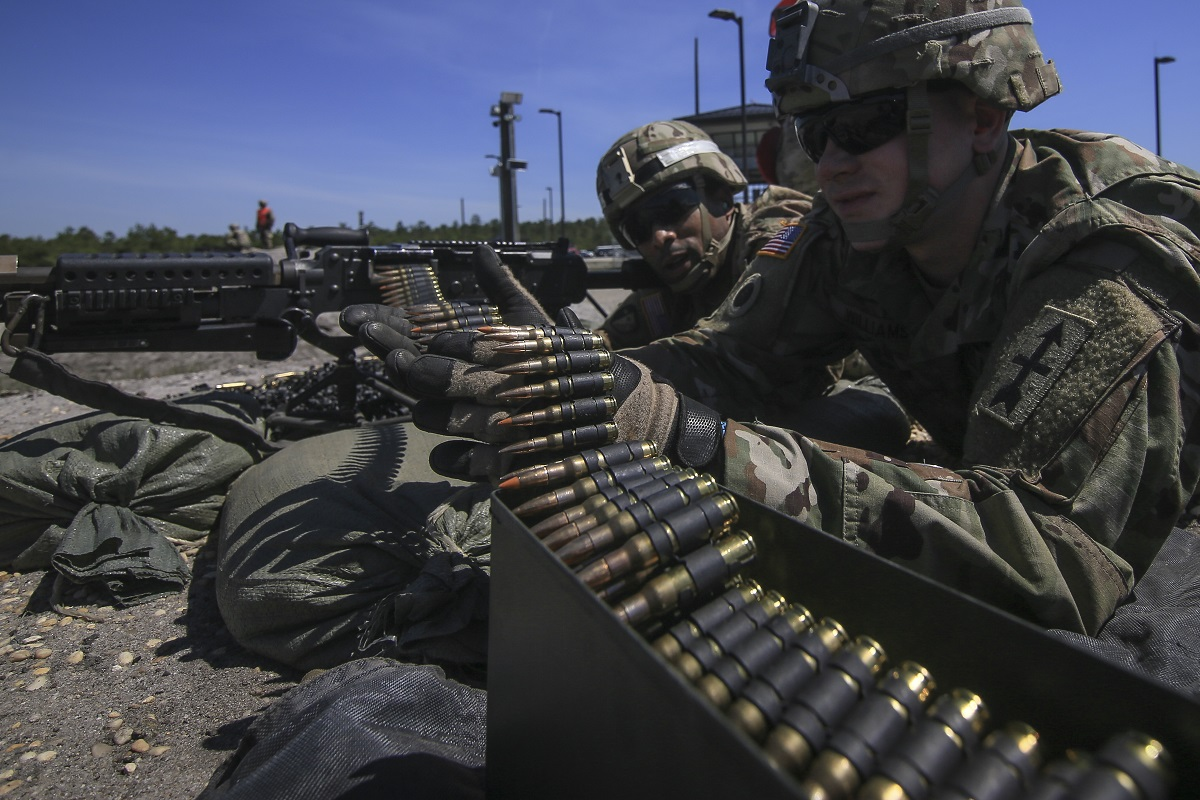 Army National Guard Soldiers fire the M240B machine gun during an advanced leader course at Joint Base McGuire-Dix-Lakehurst in New Jersey on May 2. Under a plan backed by House and Senate lawmakers, troops would see their biggest pay raise in nine years next January. (Master Sgt. Matt Hecht/Air National Guard)