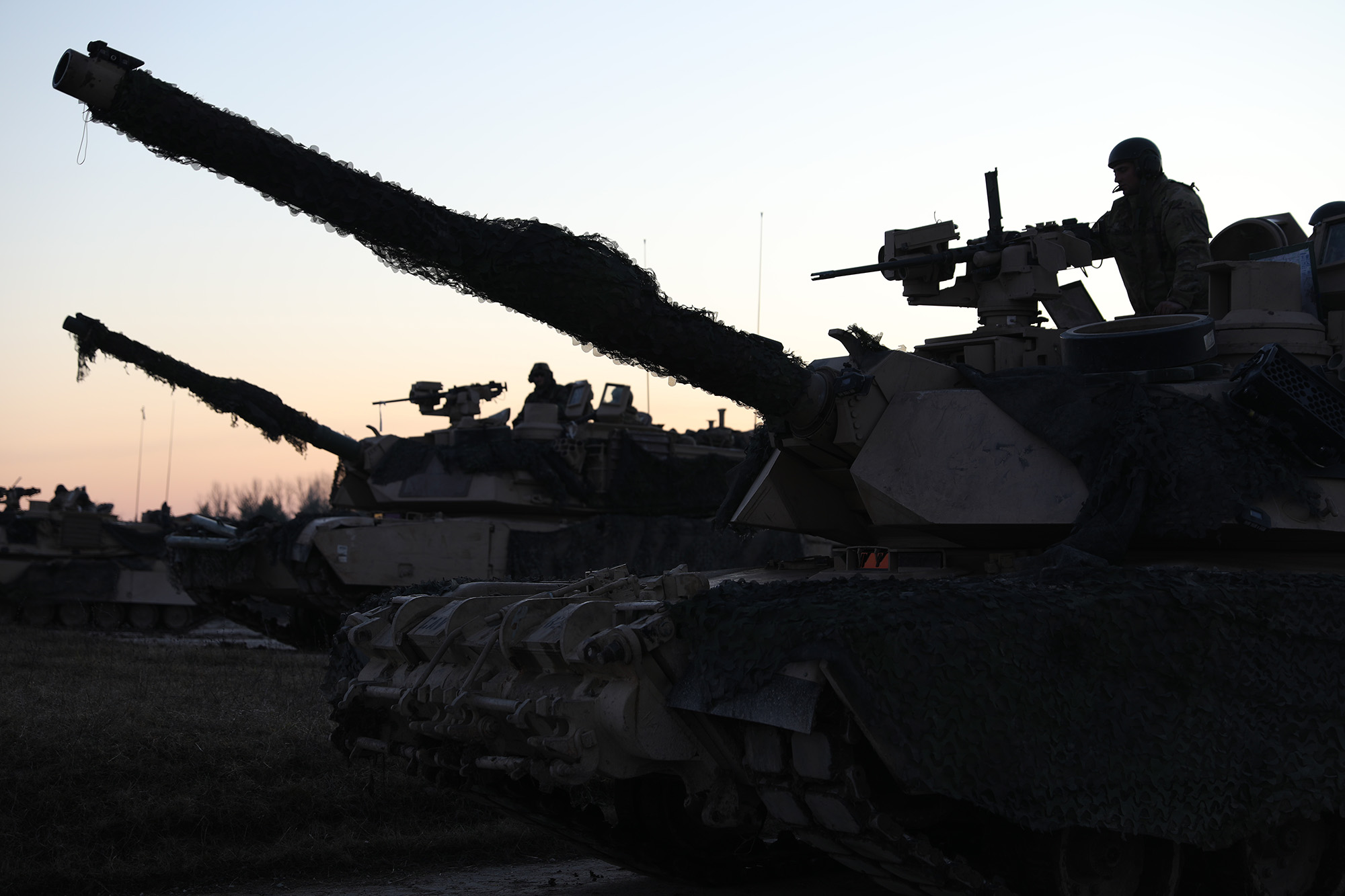 M1A2 Abrams tanks take up strategic positions during a live-fire exercise Jan. 16, 2020, in preparation for Combined Resolve XIII in Grafenwohr, Germany. (Staff Sgt. Gregory Stevens/Army National Guard)