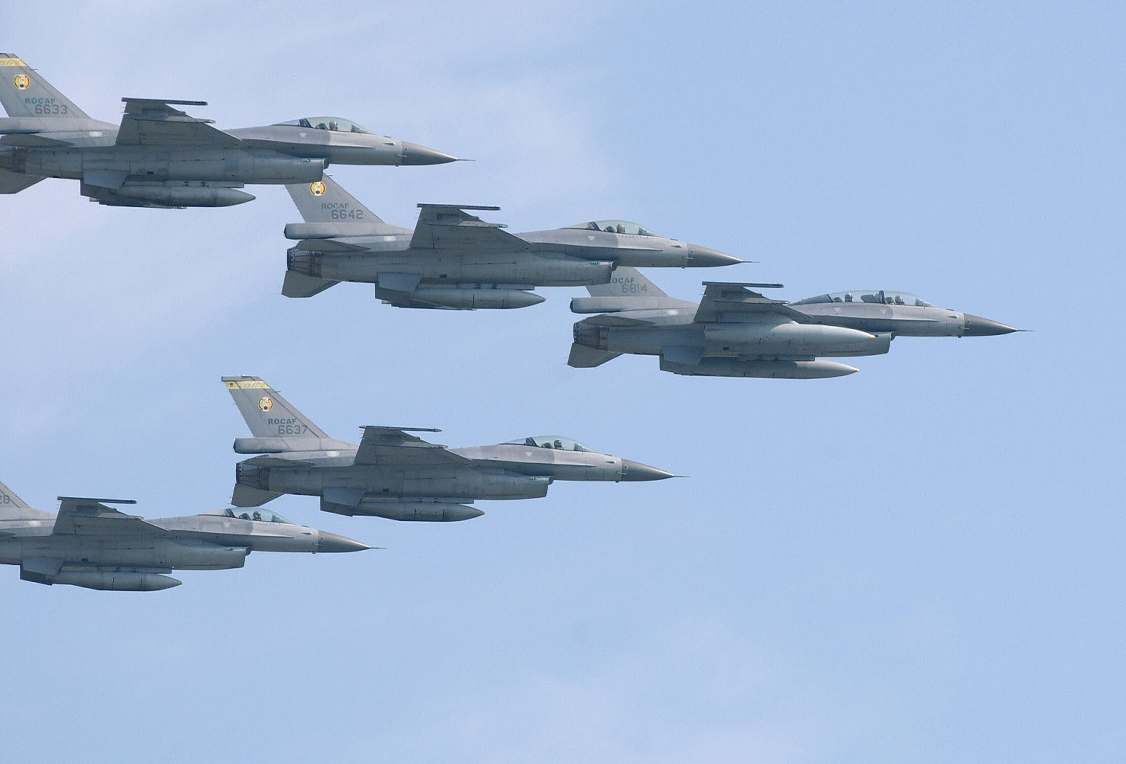 A fleet of American-made F-16 fighters from the Taiwanese Air Force fly in formation over Taipei's Sungshan airport on Sept. 2, 2007. (Patrick Lin/AFP via Getty Images)