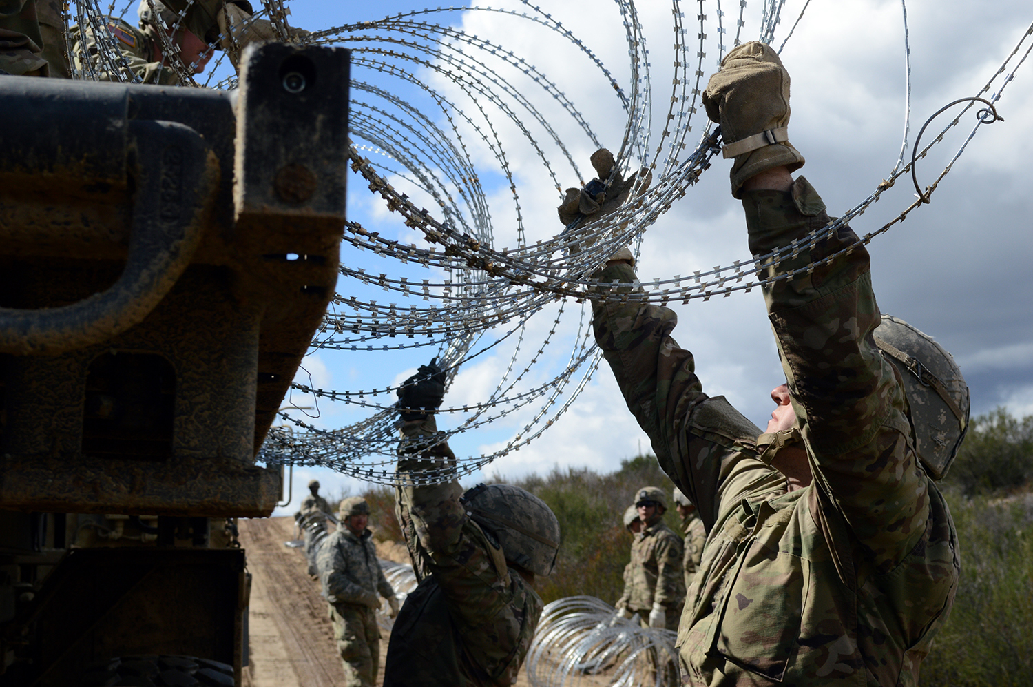 Soldiers emplace strands of concertina wire along the border fence on March 8, 2019, near Campo, Calif. (Sgt. 1st Class Ben K. Navratil/Army)
