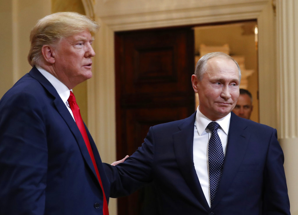 U.S. President Donald Trump, left, and Russian President Vladimir Putin leave a press conference after their meeting at the Presidential Palace in Helsinki, Finland, Monday, July 16, 2018. (Pablo Martinez Monsivais/AP)