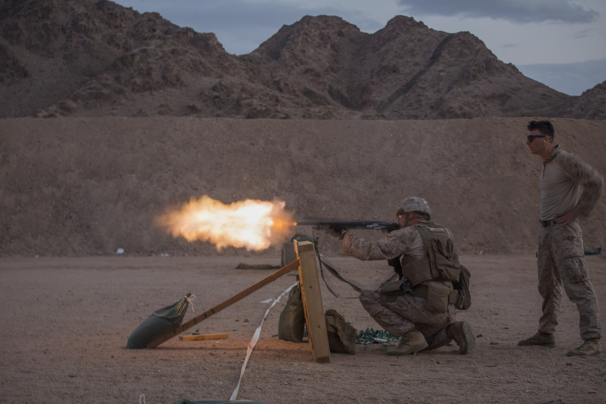 Marine Lance Cpl. David T. Shook, a designated marksman with 5th Platoon, Charlie Company, Fleet Anti-Terrorism Security Team, Central Command (FASTCENT), fires the M500 shotgun on April 3, 2019, during range operations at Camp Titin, Jordan. FASTCENT provides expeditionary antiterrorism and security forces to embassies, consulates and other vital national assets throughout the region. (Sgt. Aaron S. Patterson/Marine Corps)