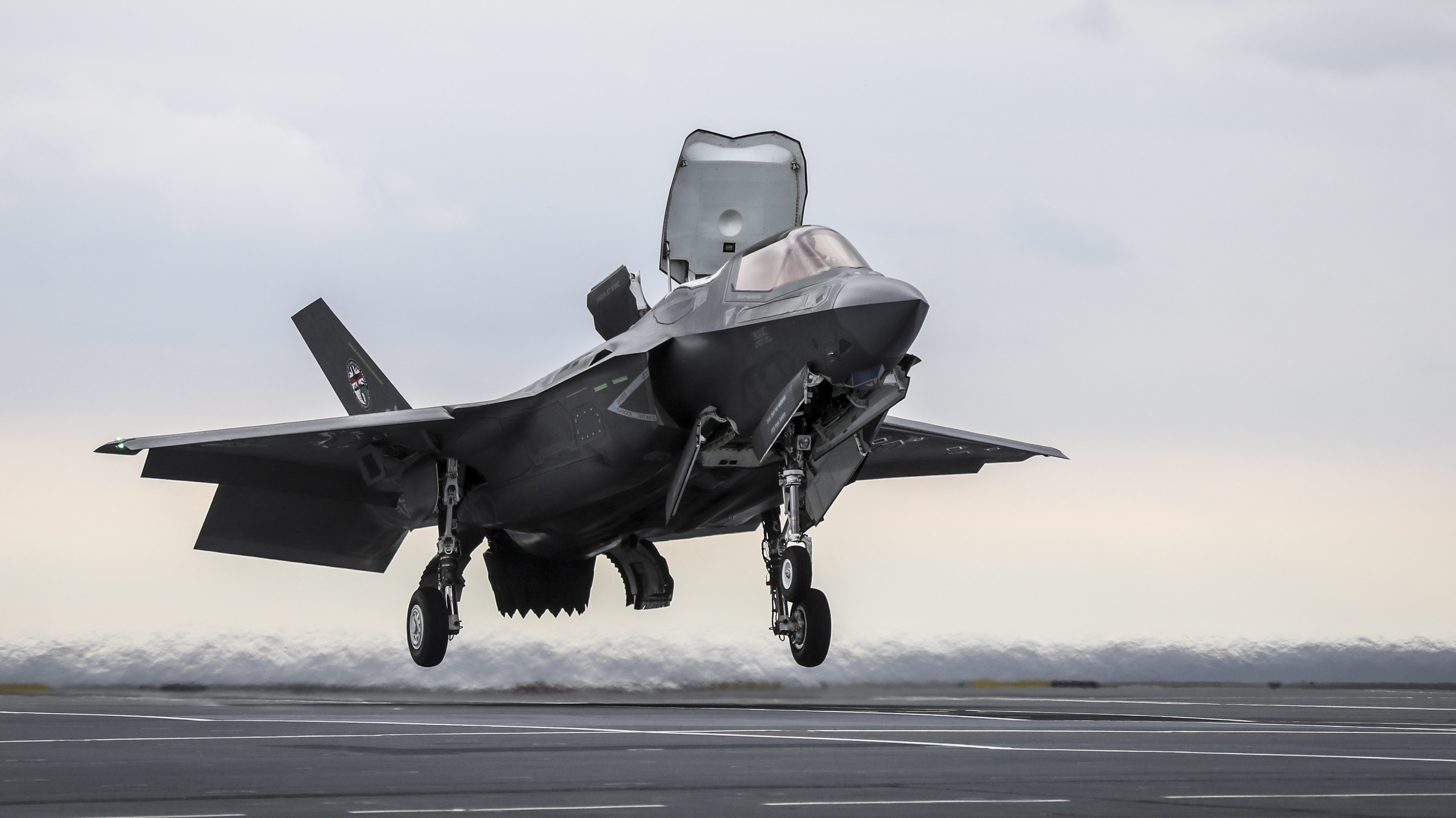 The first ever Shipborne Rolling Vertical Landing (SRVL) has been carried out with an F-35B Lightning II joint strike fighter jet conducting trials onboard the new British aircraft carrier, HMS Queen Elizabeth. The U.K. is the only nation currently planning to use the maneuver, which will allow jets to land onboard with heavier loads, meaning they wonÕt need to jettison expensive fuel and weapons before landing. (Courtesy photo by Royal Navy)