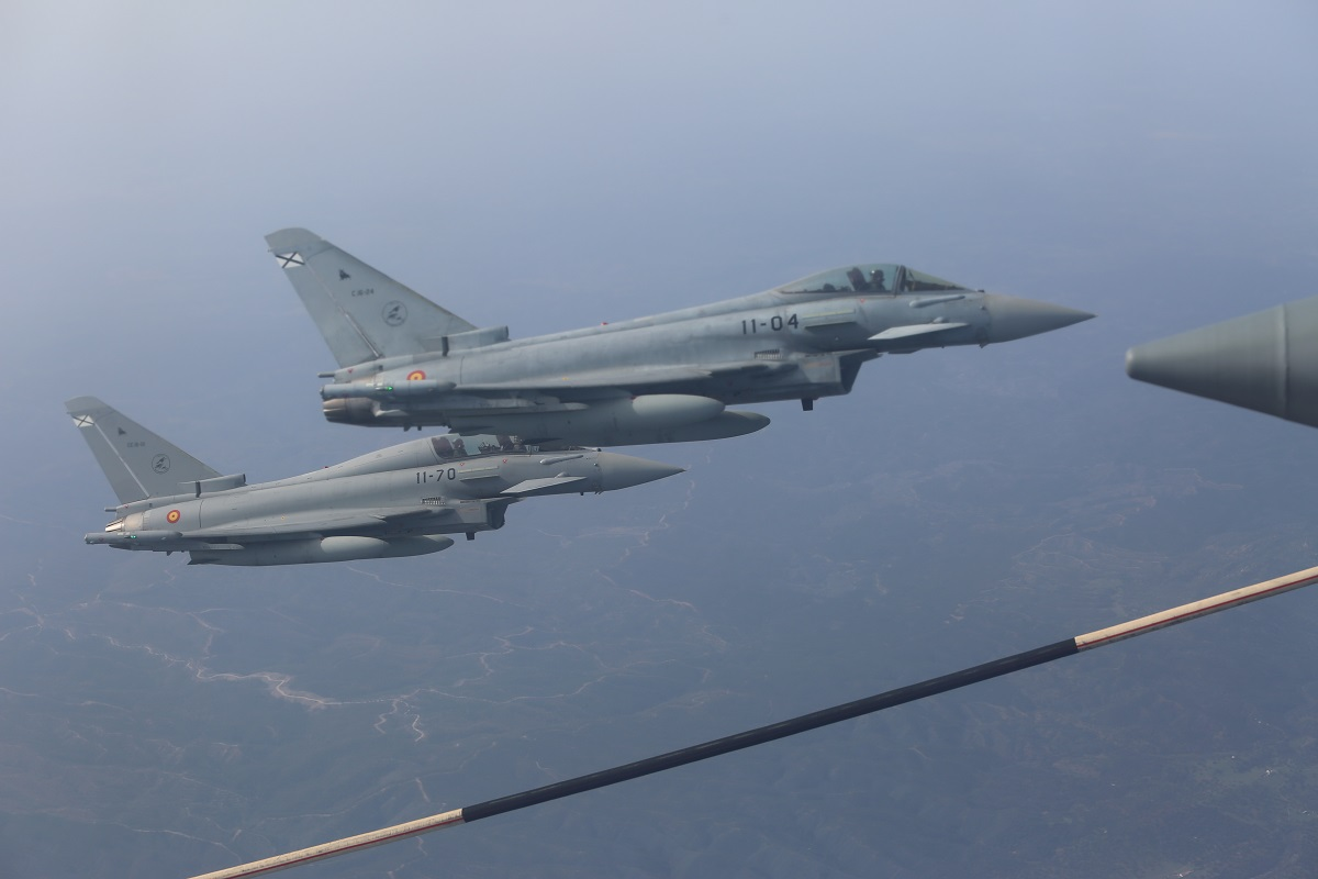 Spanish Air Force Eurofighter Typhoon jets hold security near a U.S Marine KC-130J aircraft. (Cpl. Patrick Osino/U.S. Marine Corps)