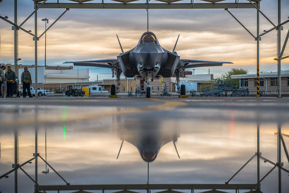 A pilot assigned to the 61st Fighter Squadron and 61st Aircraft Maintenance Unit crew chiefs prepare an F-35A Lightning II for taxi, Jan. 15, 2019 at Luke Air Force Base, Ariz. (Airman 1st Class Jacob Wongwai/Air Force)