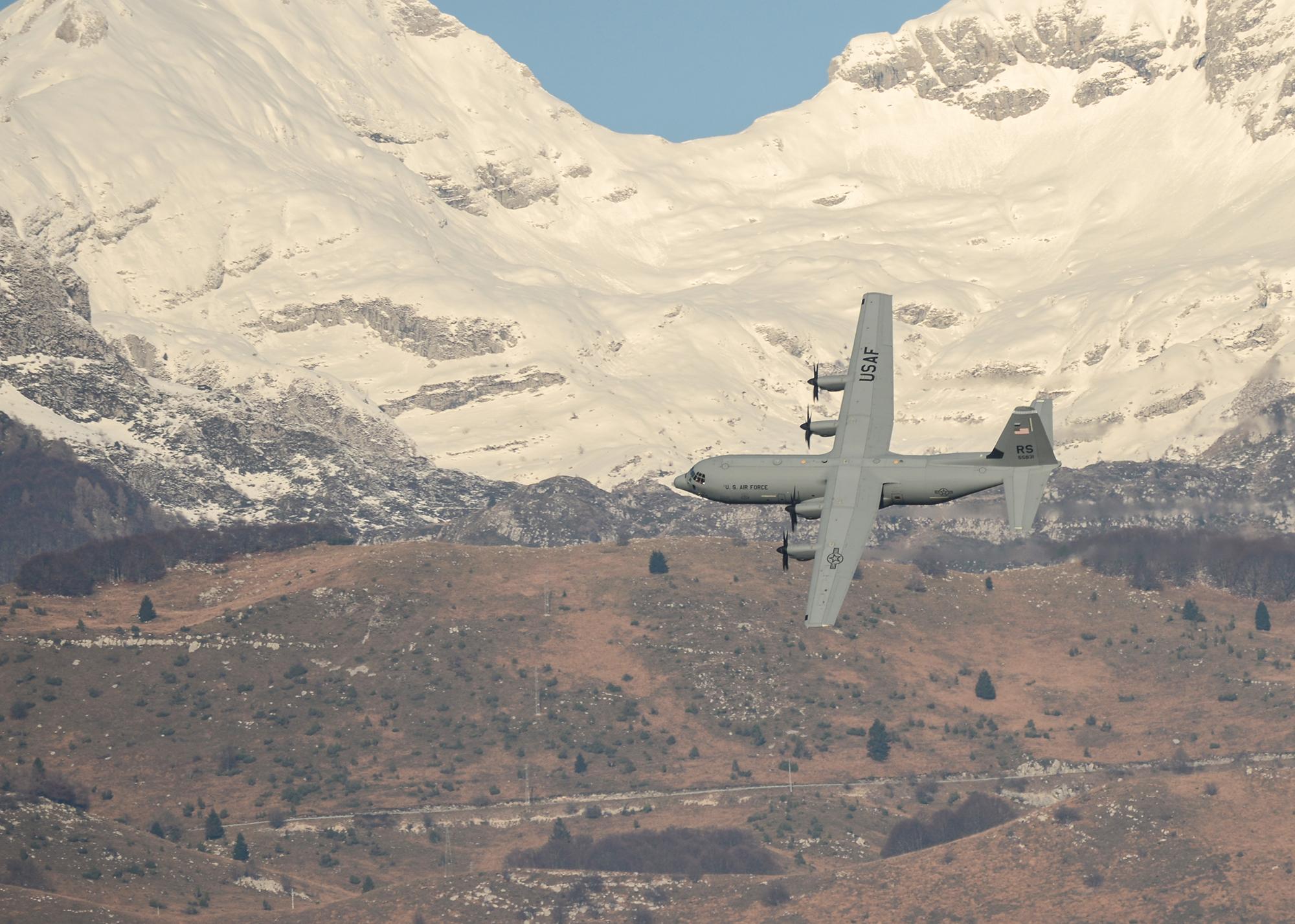 A C-130J Super Hercules flies across the Italian Dolomites at Aviano Air Bbase, Italy, Dec. 3, 2019. (Airman Thomas S. Keisler IV/Air Force)