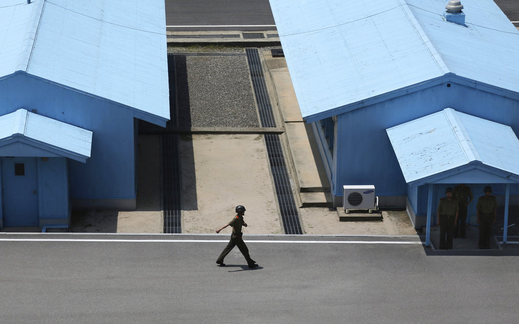 A North Korean soldier marches at the truce village at the Demilitarized Zone (DMZ) which separates the two Koreas in Panmunjom, North Korea, Wednesday, June 20, 2018. Since the summits between North Korean leader Kim Jong Un and the presidents of South Korea and the United States, things have quieted down noticeably in perhaps the most iconic symbol of the one last place on Earth where the Cold War still burns hot. (Dita Alangkara/AP)